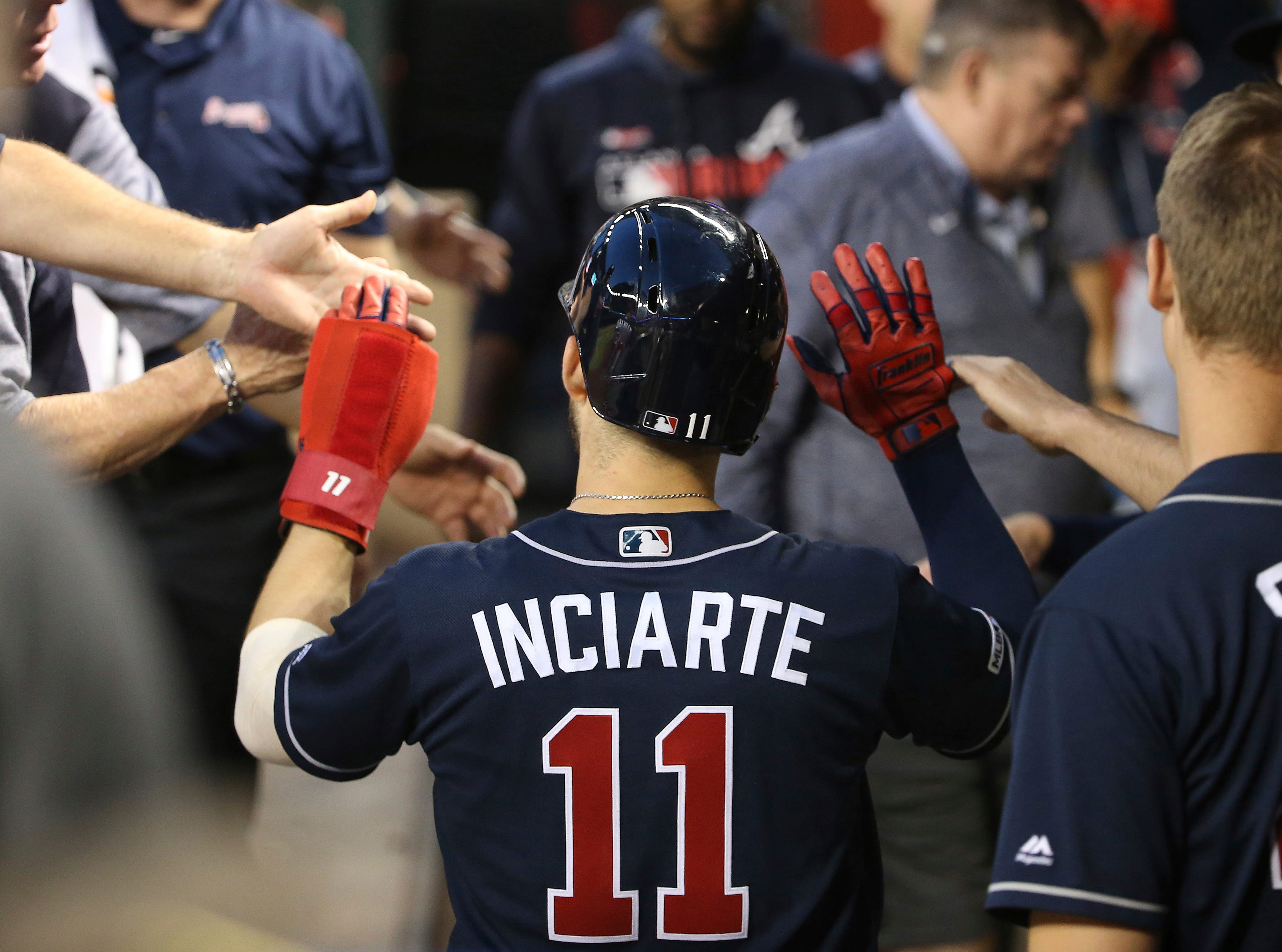 Atlanta Braves' Ender Inciarte (11) celebrates after scoring against the Arizona Diamondbacks during the third inning of a baseball game Thursday, May 9, 2019, in Phoenix. (AP Photo/Ross D. Franklin)