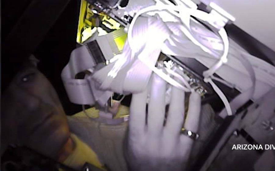 Watch criminals install a credit card skimmer