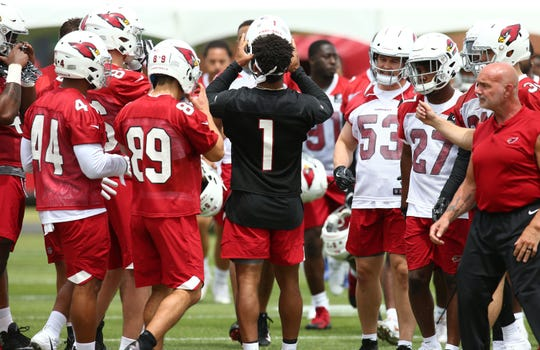 Cardinals quarterback Kyler Murray (1) joins his rookie teammates on the first day of rookie minicamp on May 10.