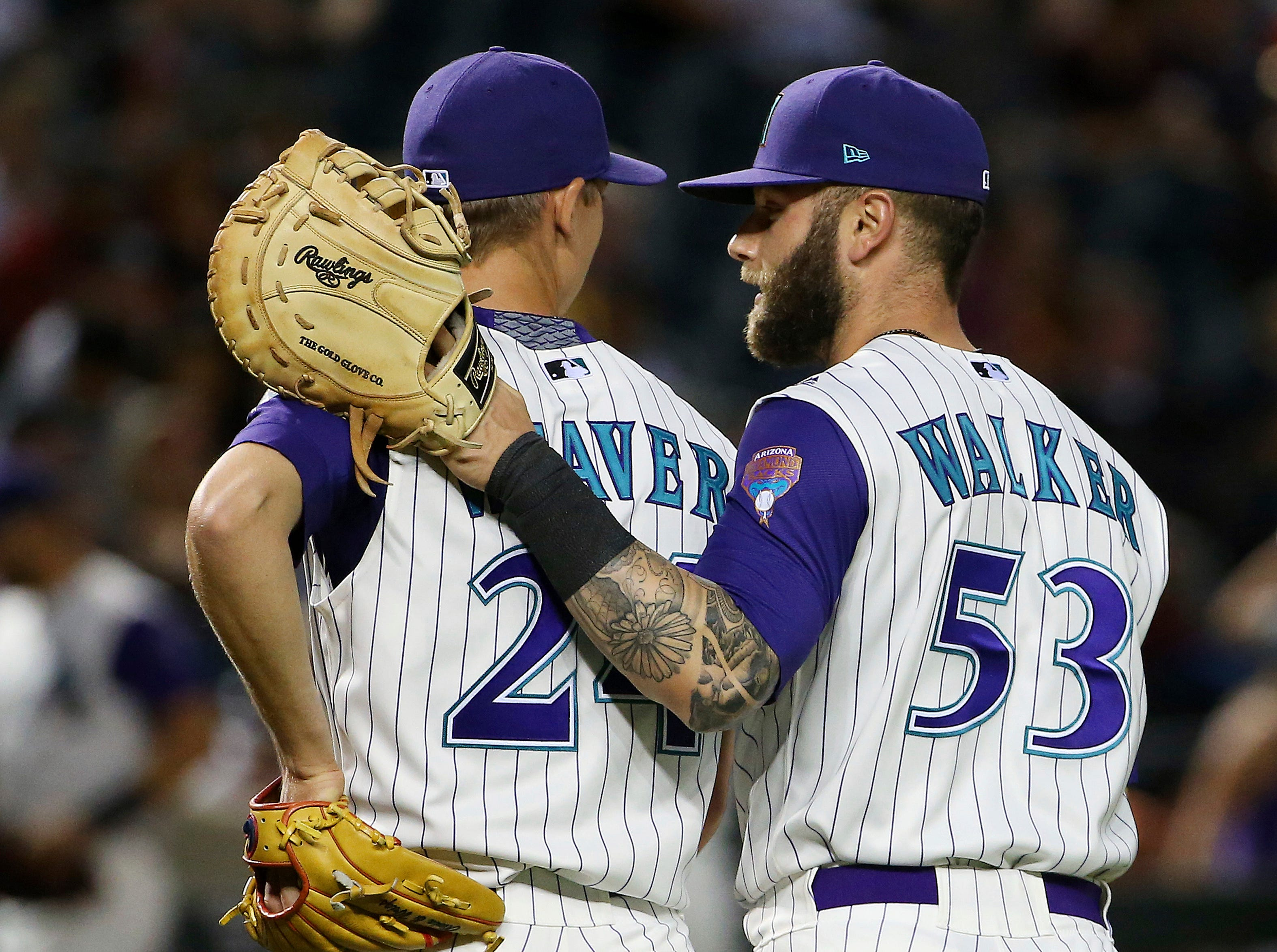 Arizona Diamondbacks first baseman Christian Walker (53) talks with pitcher Luke Weaver, left, as they both walk off the field after the third out during the third inning of the team's baseball game against the Atlanta Braves Thursday, May 9, 2019, in Phoenix. (AP Photo/Ross D. Franklin)