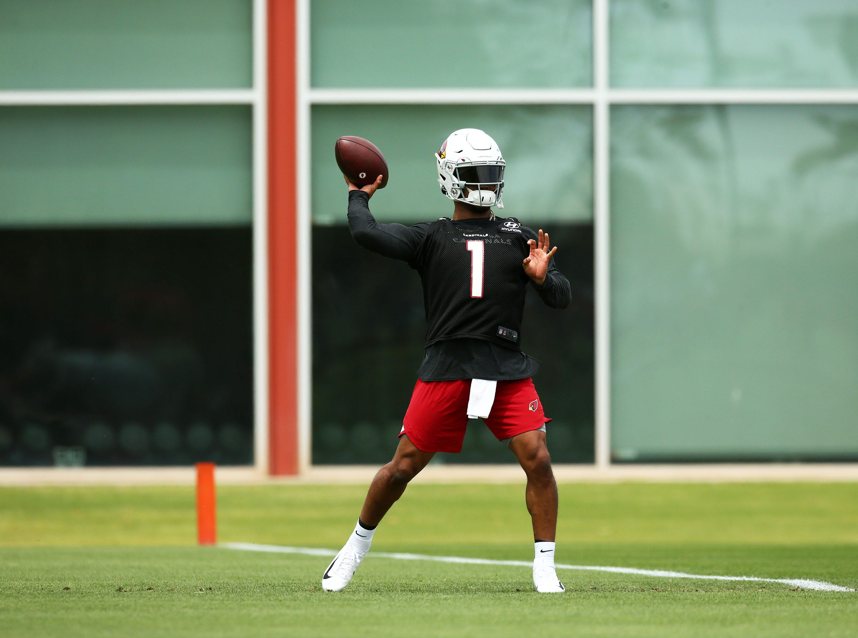 Cardinals quarterback Kyler Murray looks to throw during a drill at rookie minicamp on May 10.