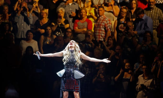 """Carrie Underwood performs during her Cry Pretty Tour at Talking Stick Resort Arena in Phoenix on May 9, 2019.&nbsp;<strong>Read the review:&nbsp;</strong><a href=""""https://www.azcentral.com/story/entertainment/music/2019/05/10/carrie-underwood-concert-review-phoenix-talking-stick-resort-arena/1134110001/"""">Carrie Underwood soars on &#39;tour full of ladies&#39;</a>"""