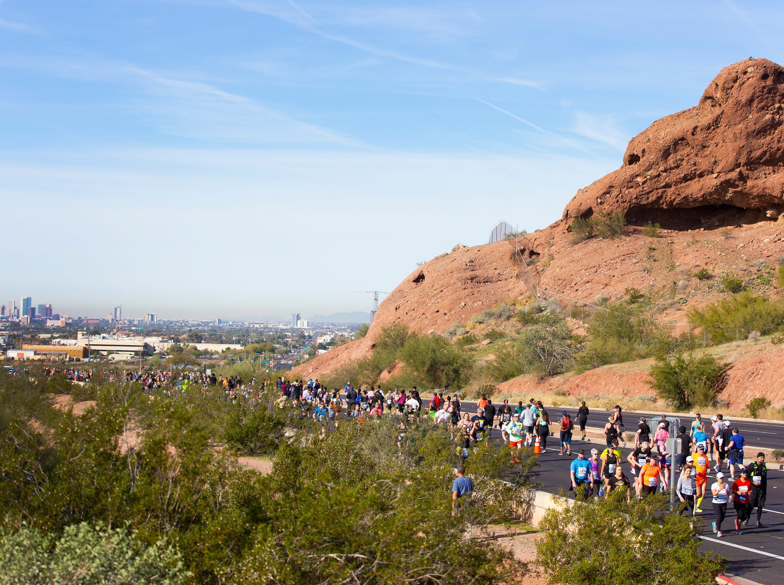 Runners compete in Humana Rock 'n' Roll half marathon near Papago Park on Jan. 20, 2019.
