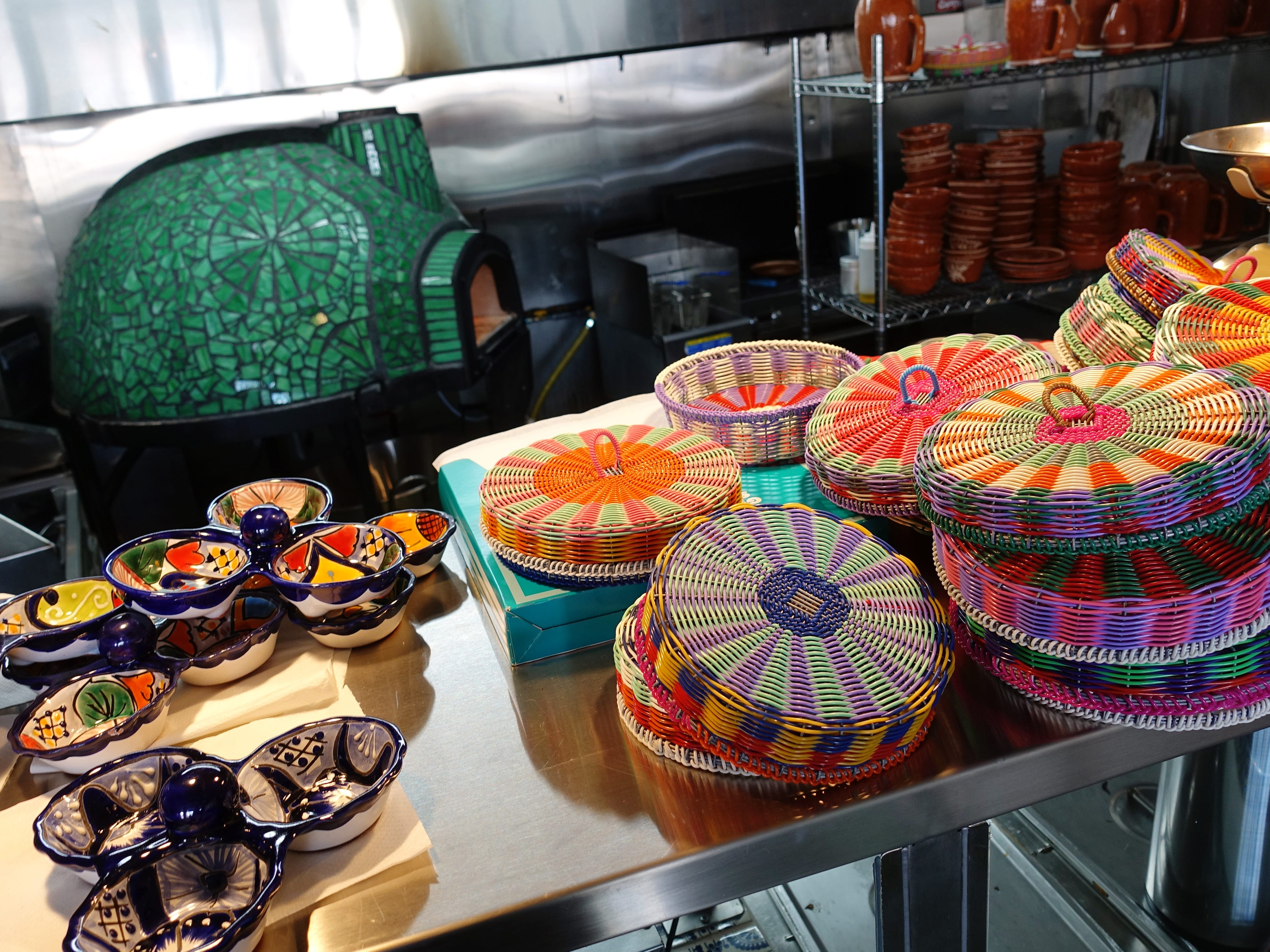 Tortilla baskets and salsa bowls in front of the kitchen's clay oven at La Marquesa in Phoenix.