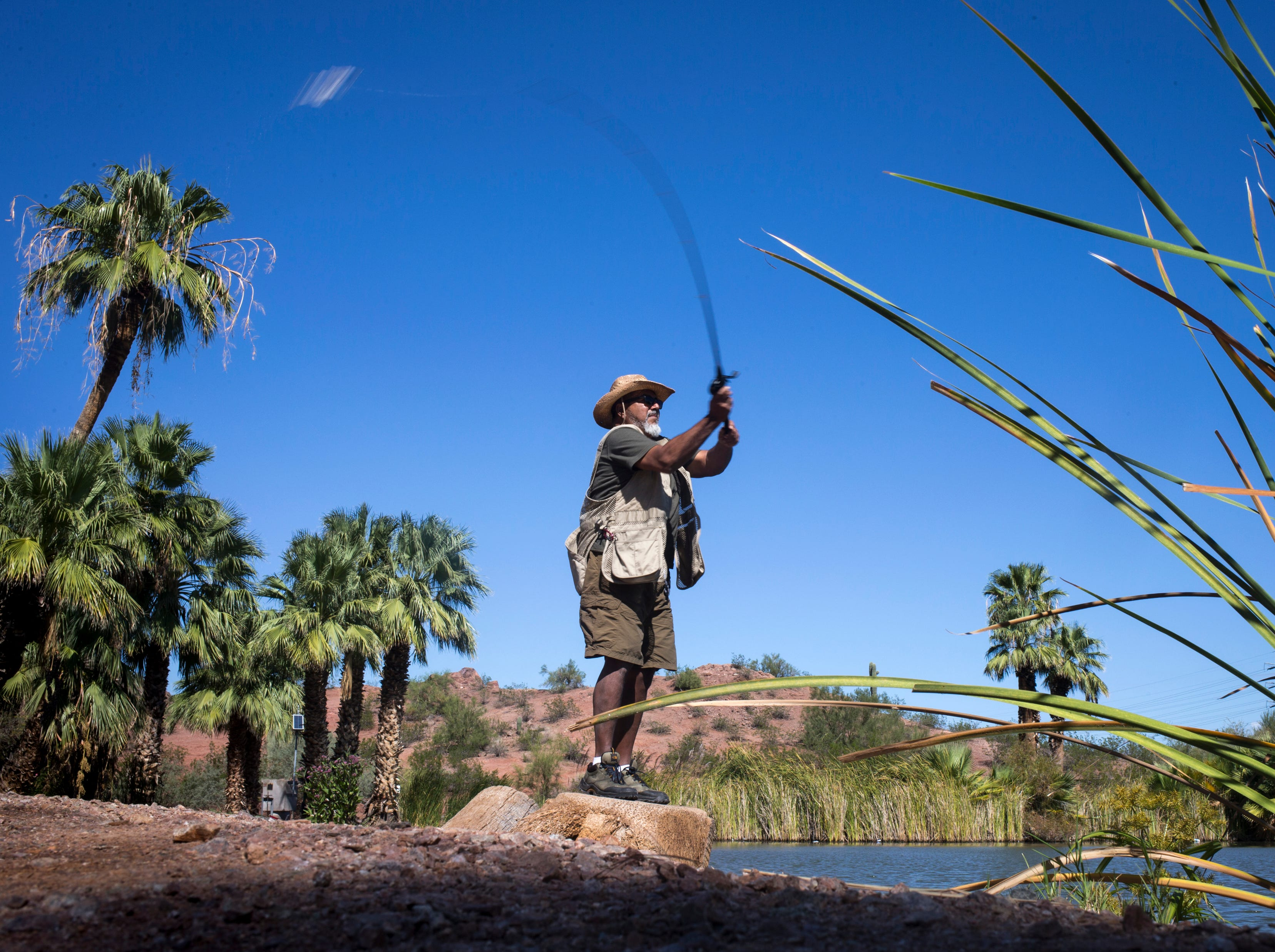 Ken Soto casts for bass Oct. 15, 2018, while fishing at Papago Park in Phoenix.