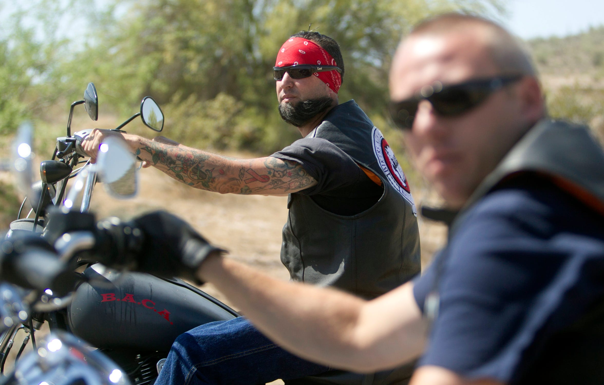 Members of the Bikers Against Child Abuse ride up to Payson.