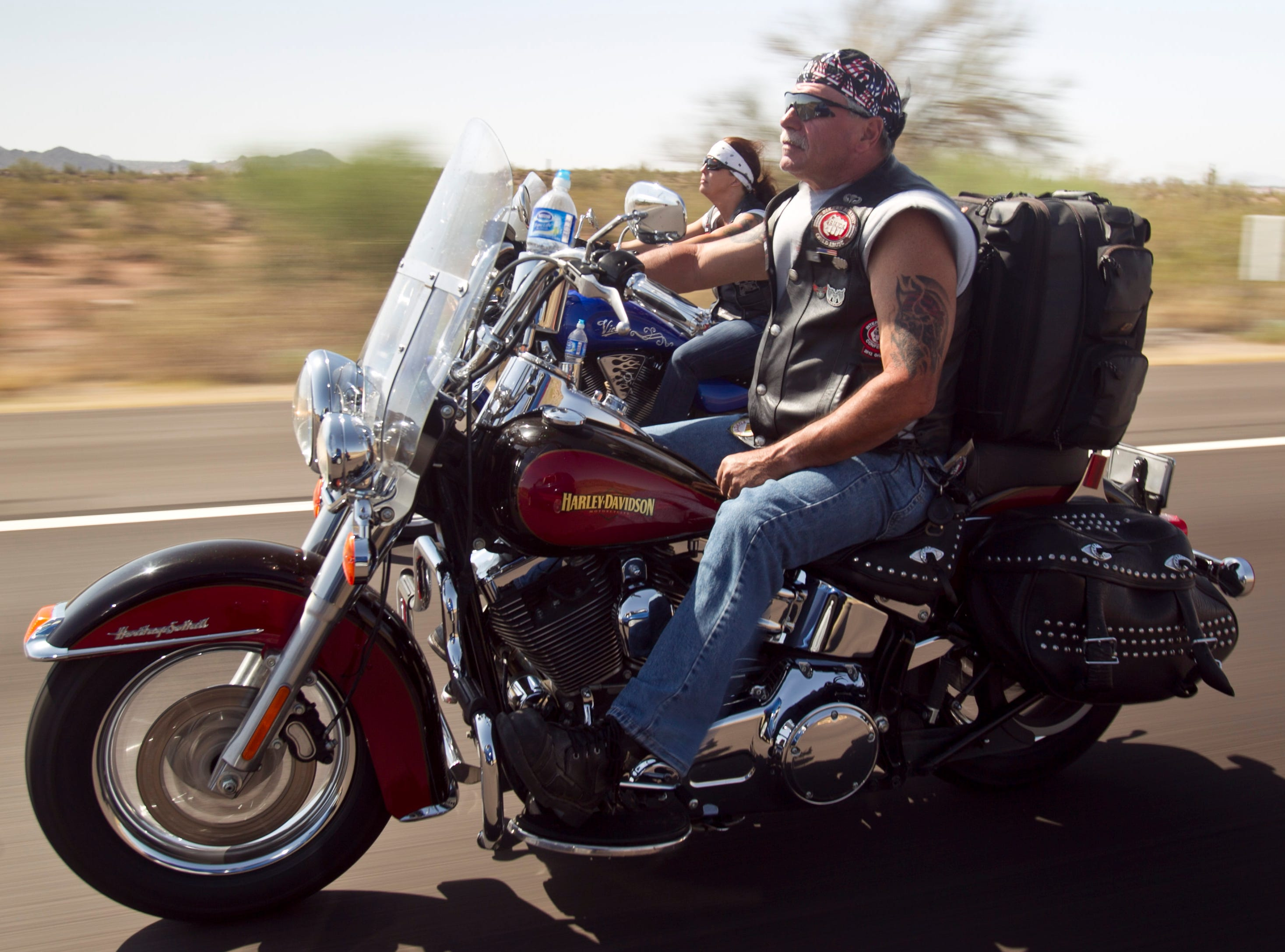 Father T of Bikers Against Child Abuse rides up to Payson during a group ride.