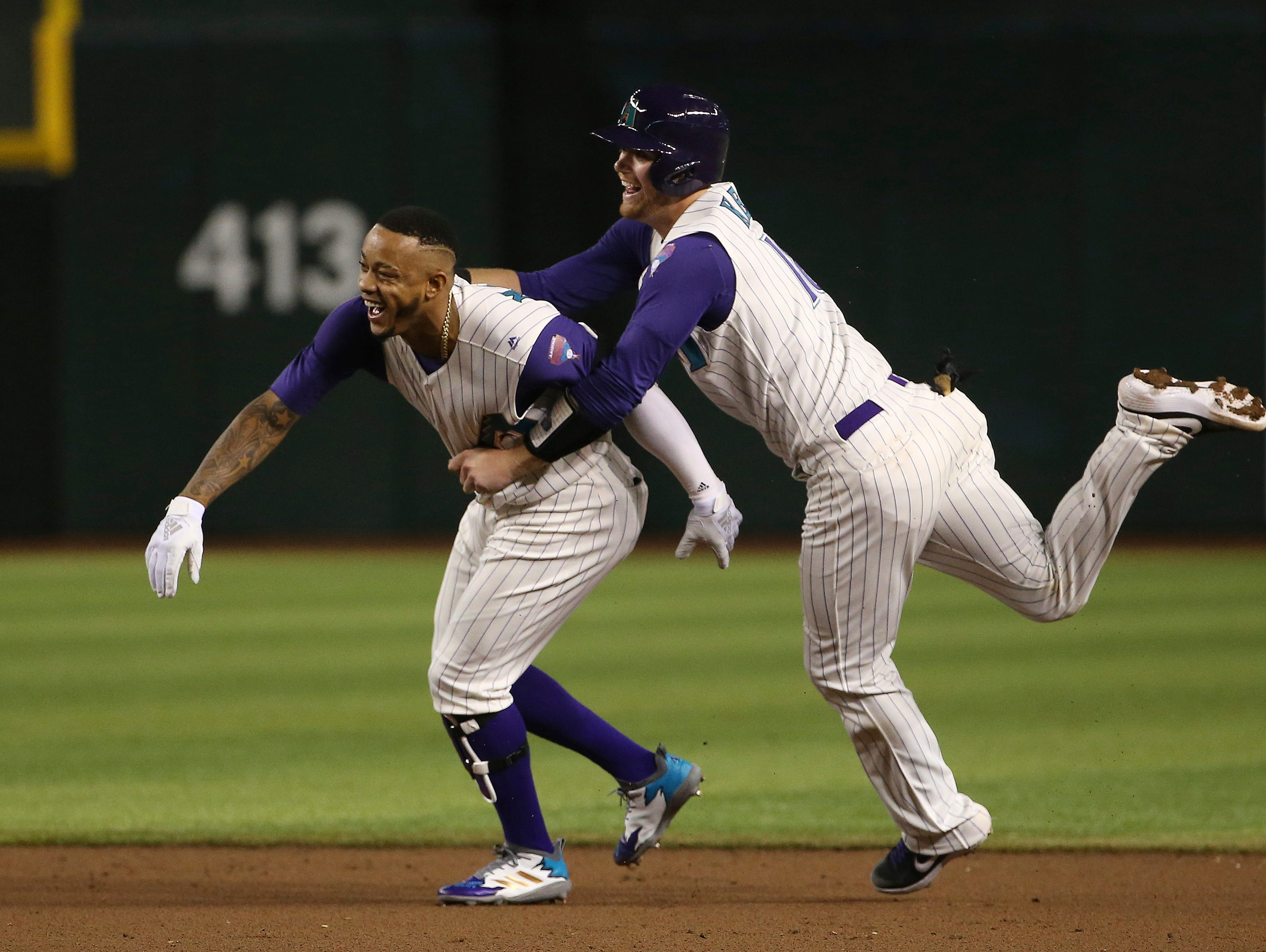 Arizona Diamondbacks' Ketel Marte, left, celebrates his game-winning single against the Atlanta Braves with Carson Kelly, right, during the 10th inning of a baseball game Thursday, May 9, 2019, in Phoenix. The Diamondbacks wopn 3-2. (AP Photo/Ross D. Franklin)
