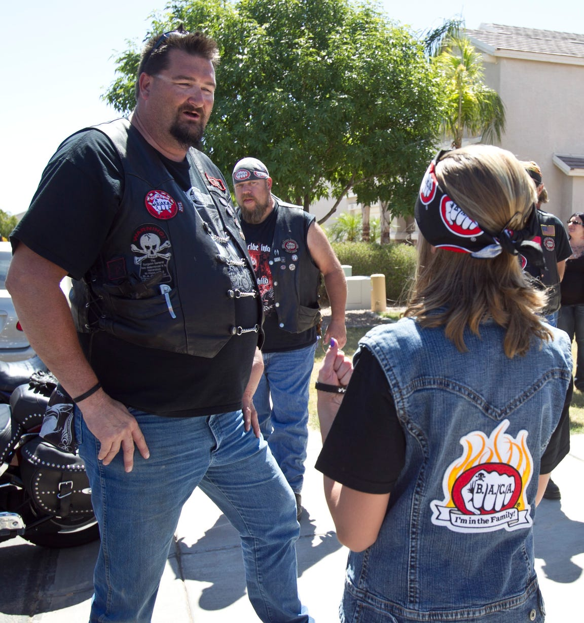 Tree, a member of Bikers Against Child Abuse, is excited that a new child that the group is serving has chosen his motorcycle to ride during the group's initiation process.
