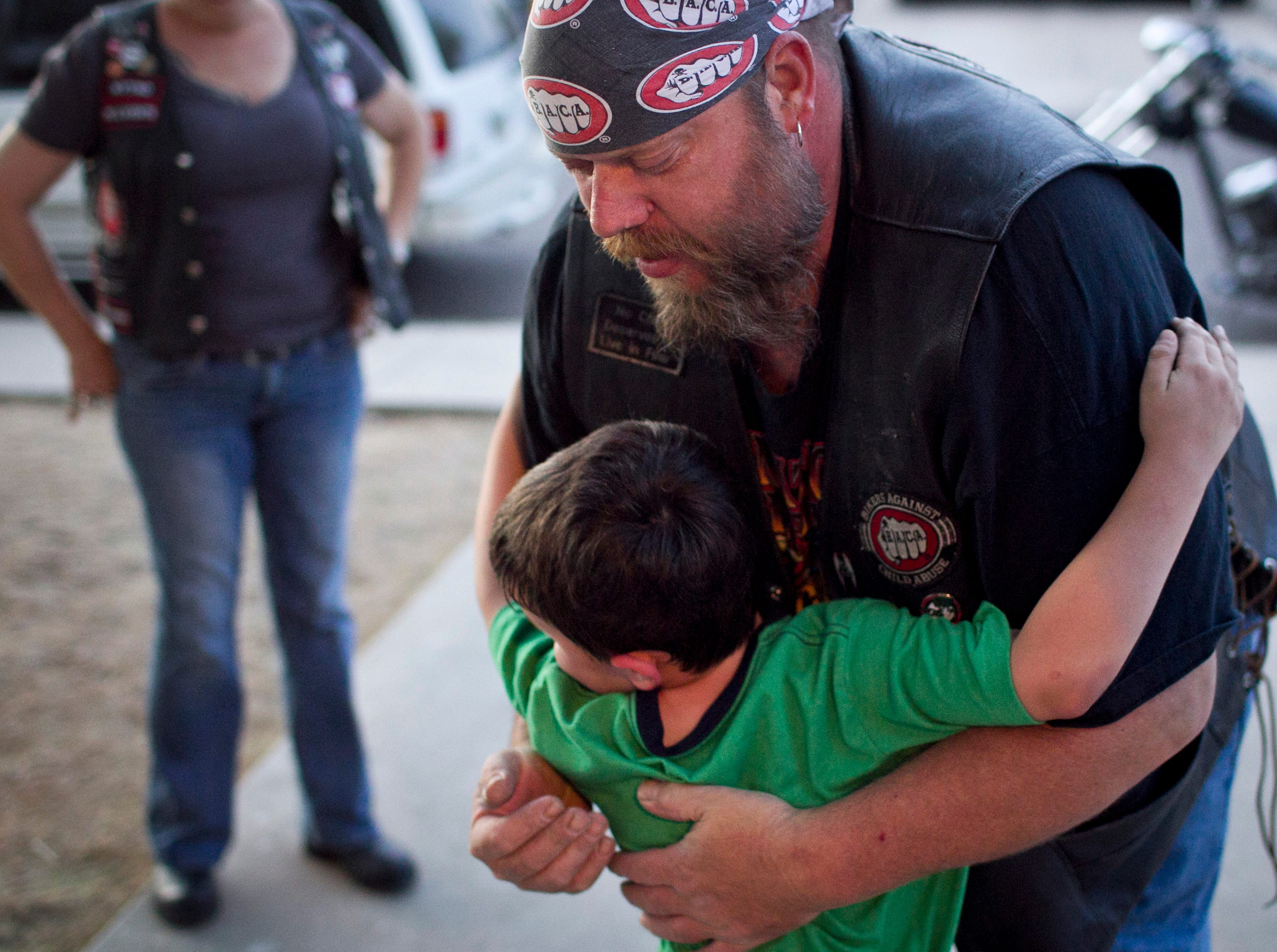 Fast Track give Rock from Bikers Against Child Abuse a hug during a visit.