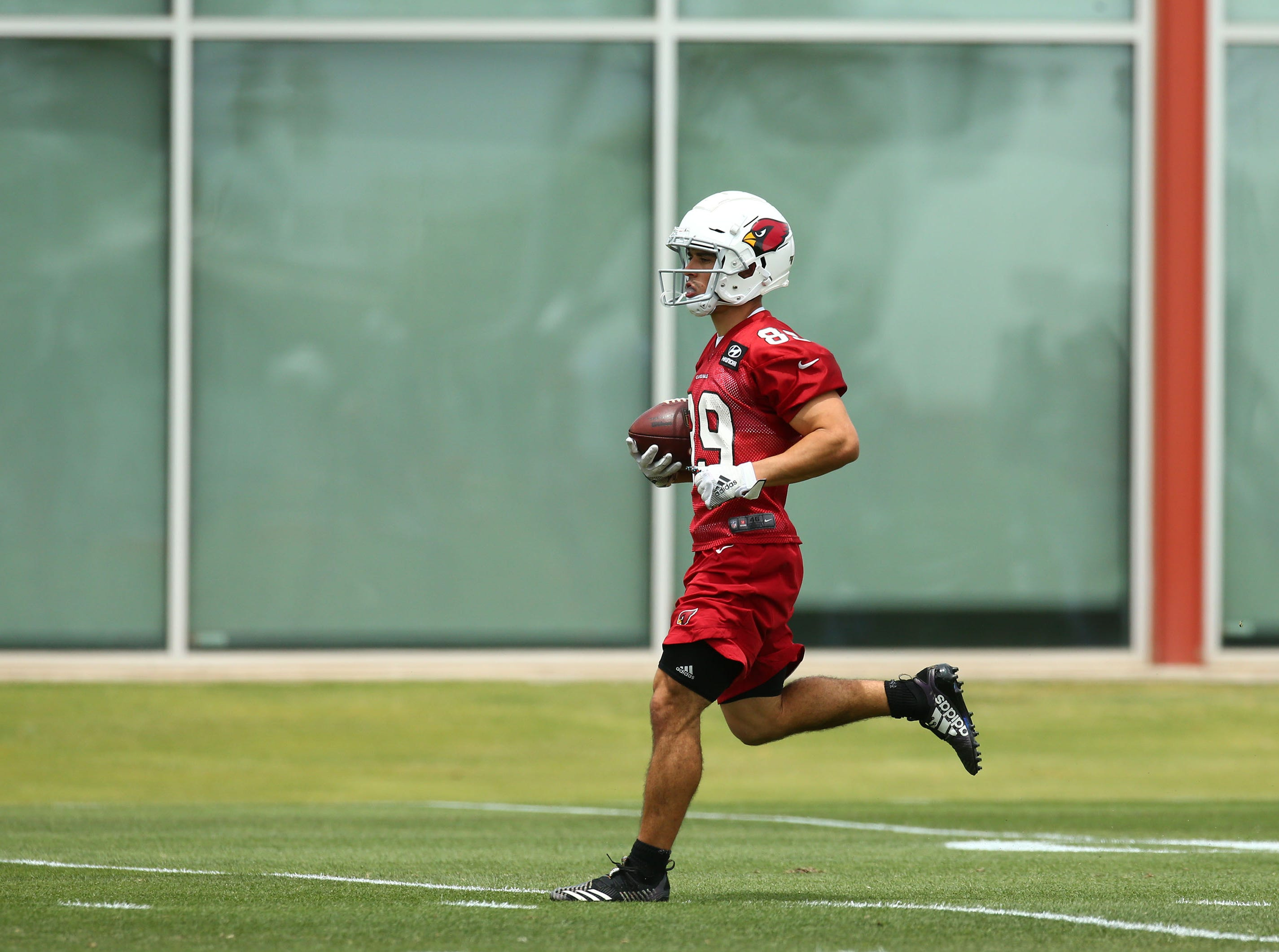 Cardinals receiver Andy Isabella (89) runs with the ball during the first day of rookie minicamp on May 10.