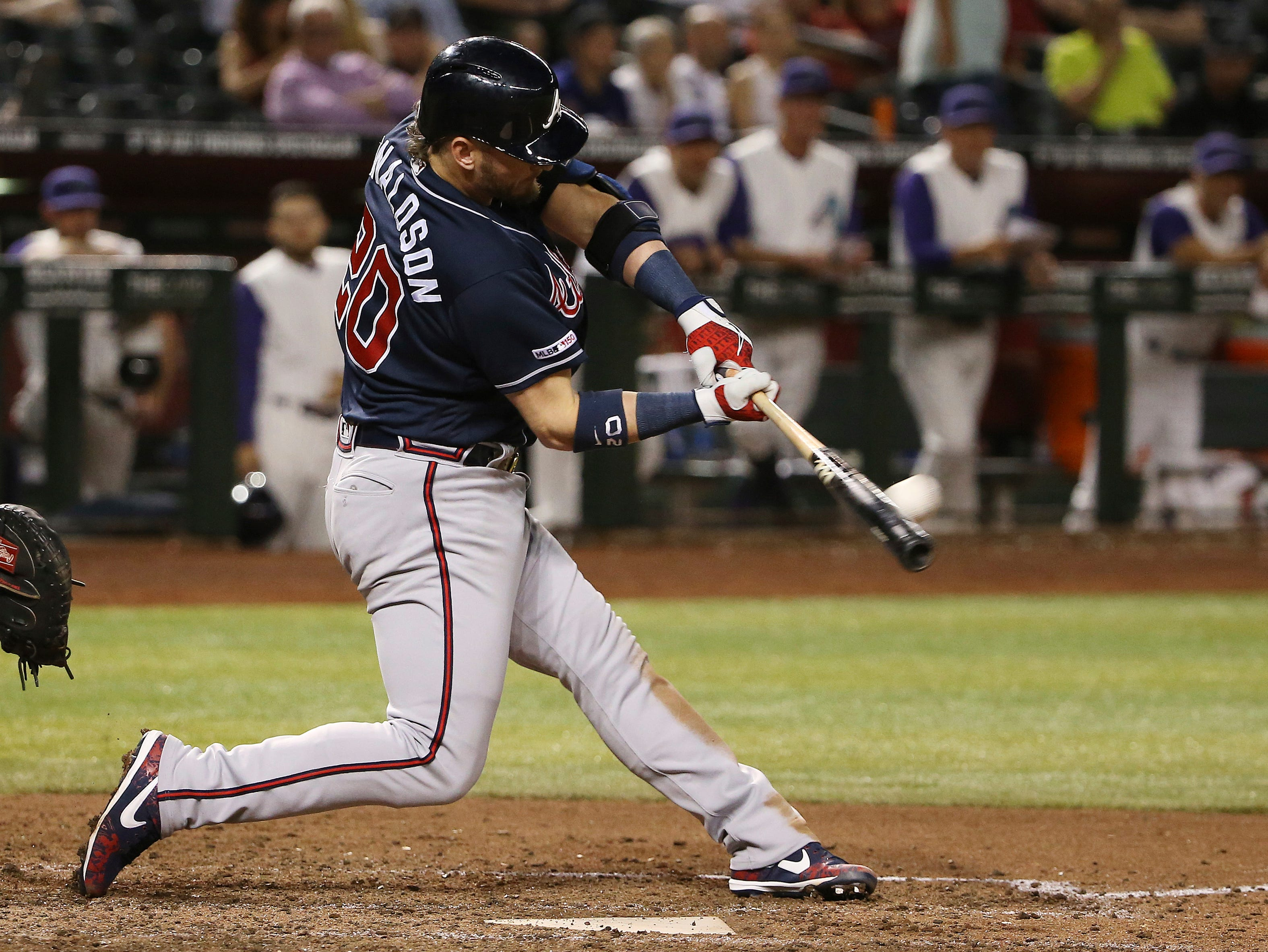 Atlanta Braves' Josh Donaldson connects for a home run against the Arizona Diamondbacks during the ninth inning of a baseball game Thursday, May 9, 2019, in Phoenix. (AP Photo/Ross D. Franklin)
