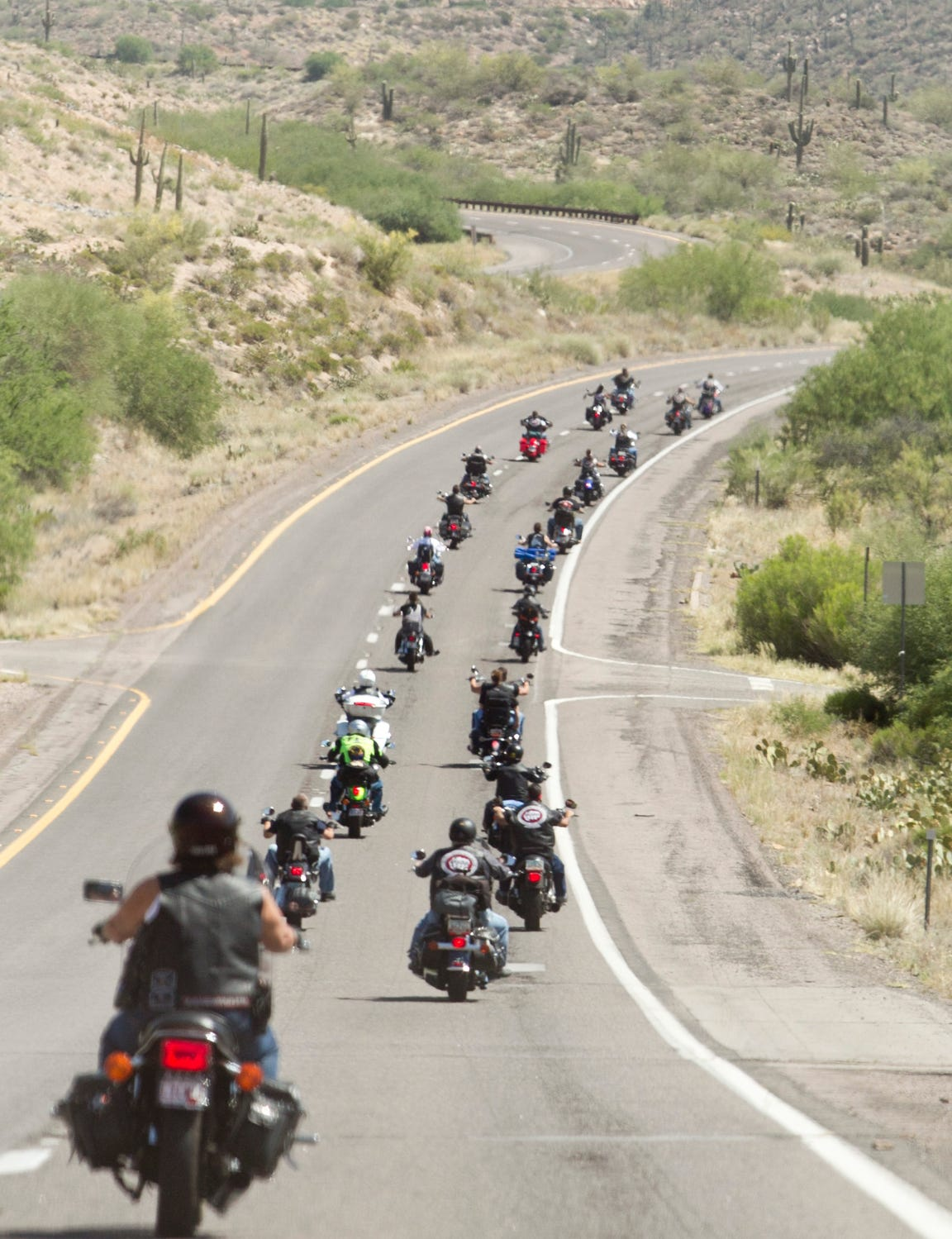 The bikers are all volunteers, giving five, 10, 20 or more hours a week. There's no reimbursement for gas or the time they take off work. They have to go through background checks and prove themselves to the group. But each has a reason for doing so.