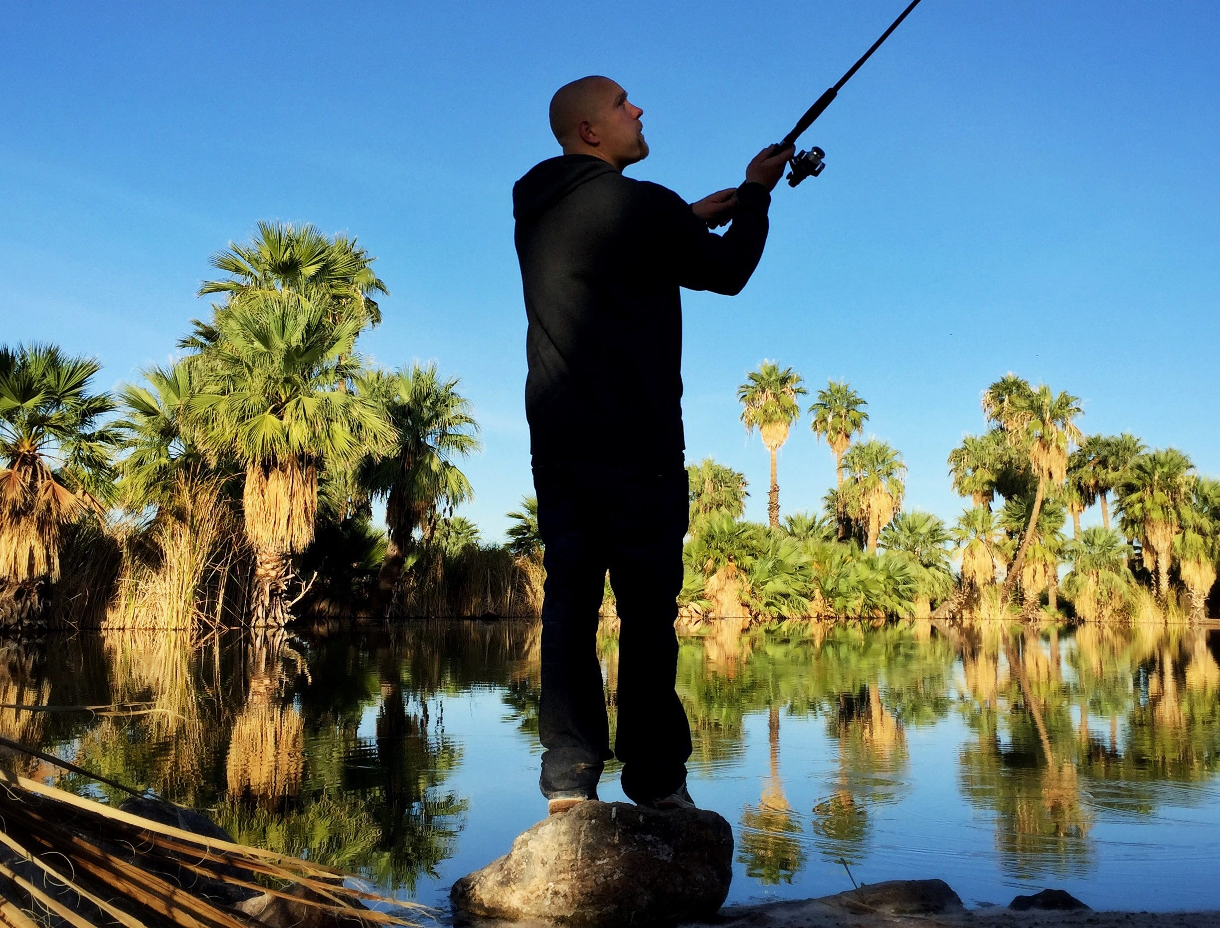 Justin Wilkins fishes for bass Nov. 22, 2017, at Papago Park in Phoenix.