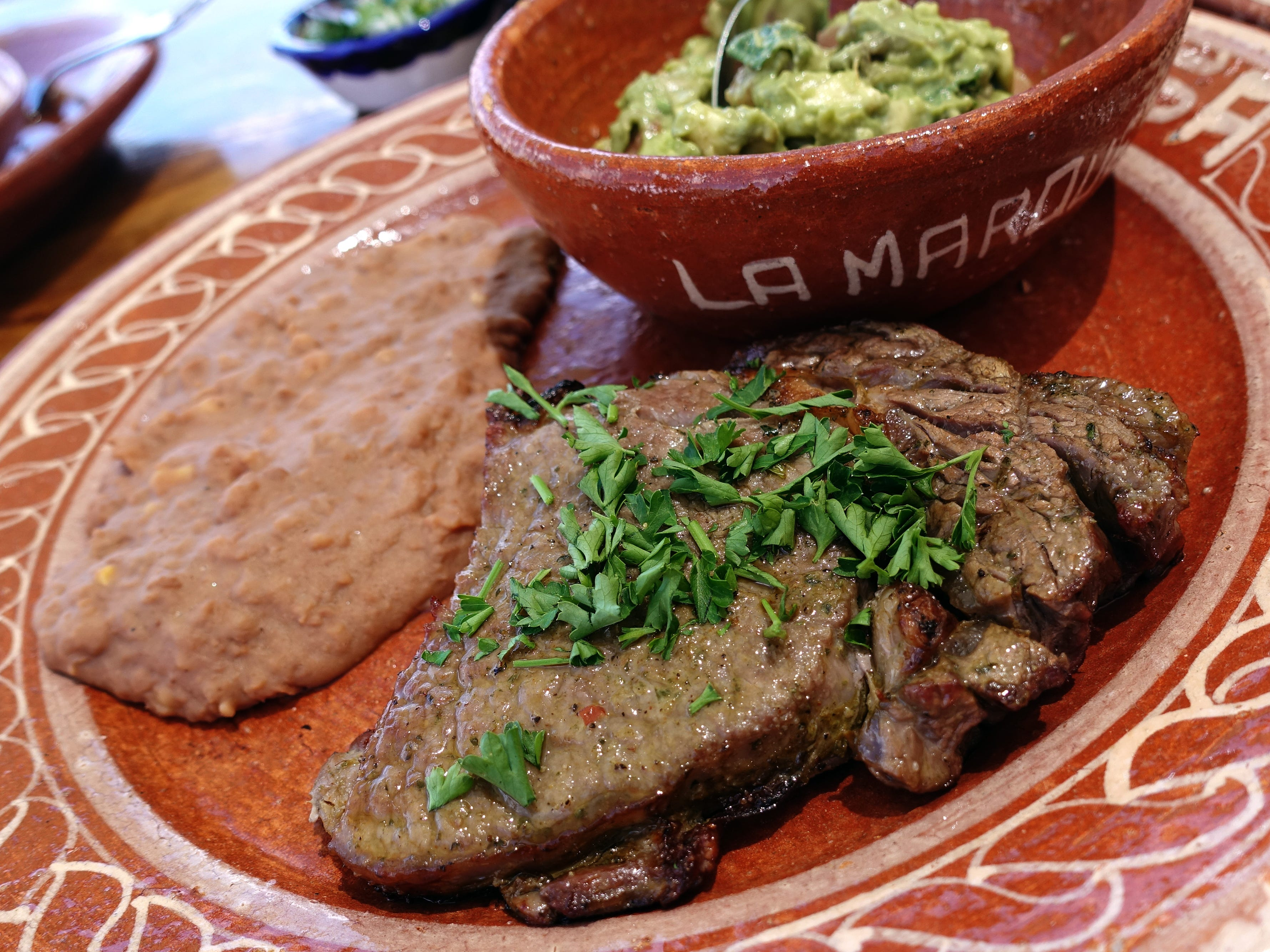 Roasted ribeye steak with frijoles refritos and guacamole at La Marquesa in Phoenix.