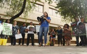 Nicole Hale leads during a protest against cash bail at the Maricopa County Attorney's office in Phoenix on May 9, 2019.