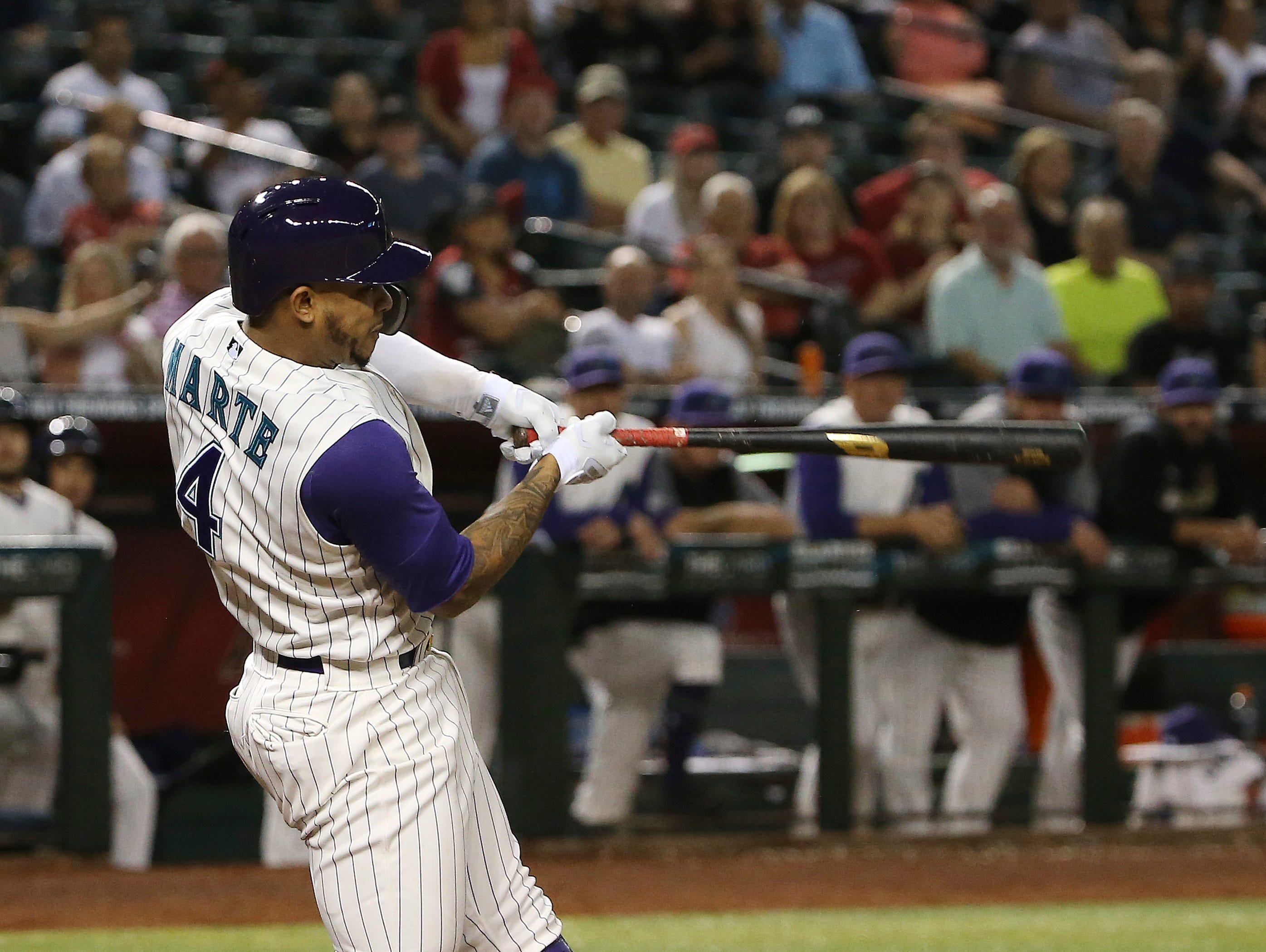 Arizona Diamondbacks' Ketel Marte hits a single to drive in the winning run against the Arizona Diamondbacks during the 10th inning of a baseball game Thursday, May 9, 2019, in Phoenix. The Diamondbacks won 3-2. (AP Photo/Ross D. Franklin)