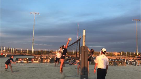 Desert Vista's Brooke Blutreich scores the winning point in the Arizona high school beach volleyball championship game.