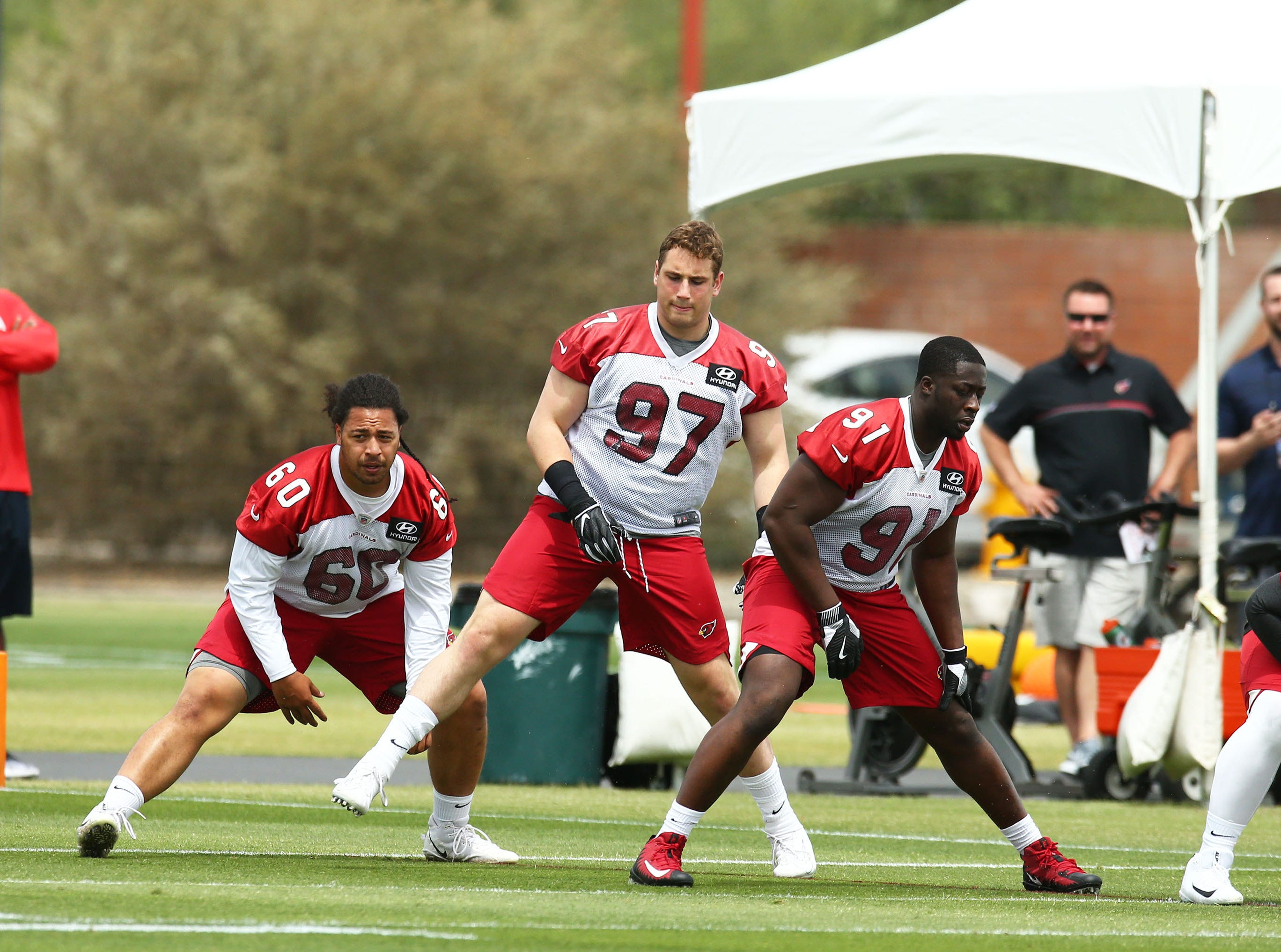 Arizona Cardinals defensive lineman Peli Anau (60), defensive lineman Zach Allen (97) and defensive lineman Michael Dogbe (91) during rookie mini-camp on May 10, 2019 in Tempe, Ariz.