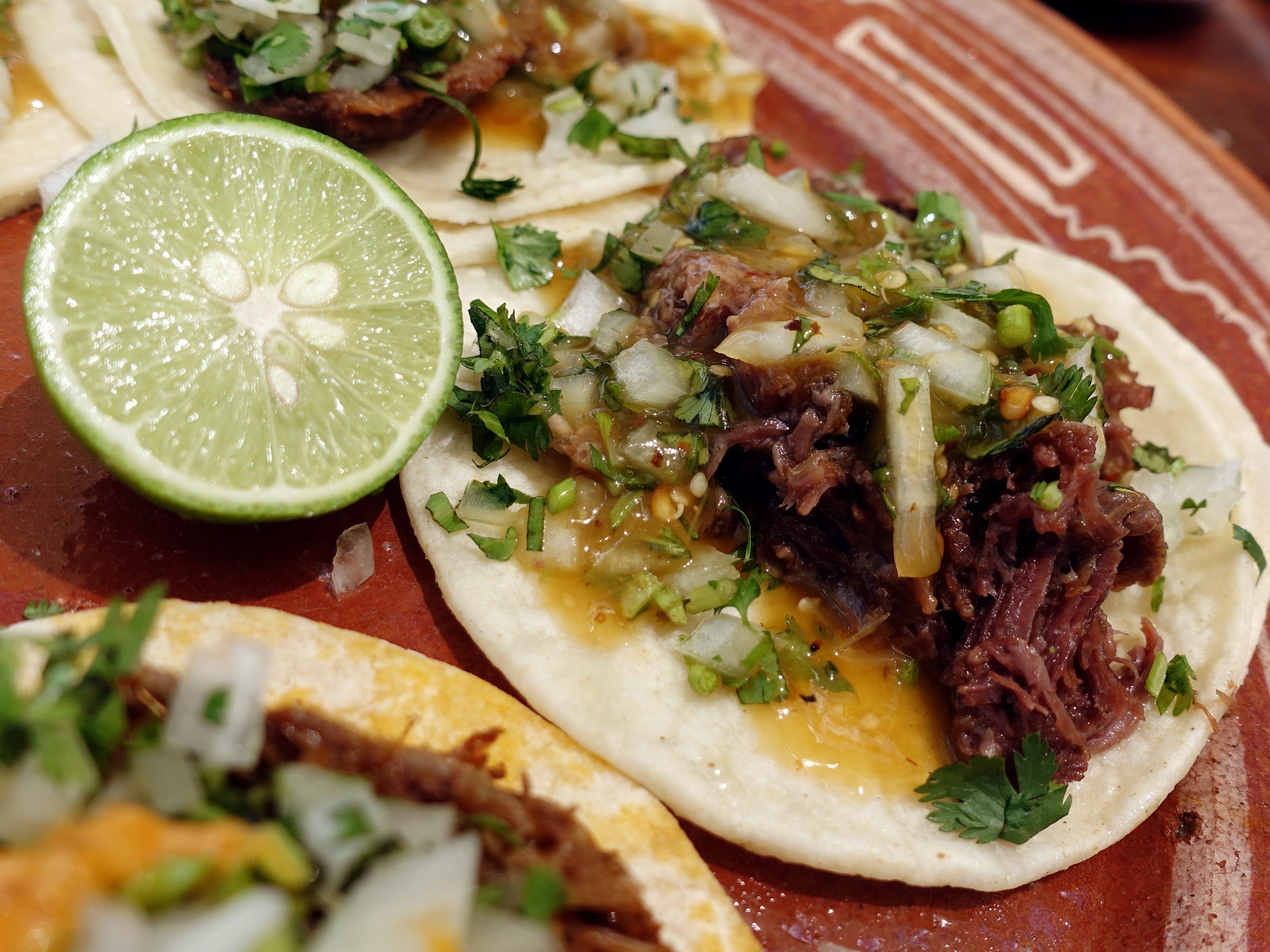 Birria de chivo tacos at La Marquesa in Phoenix.