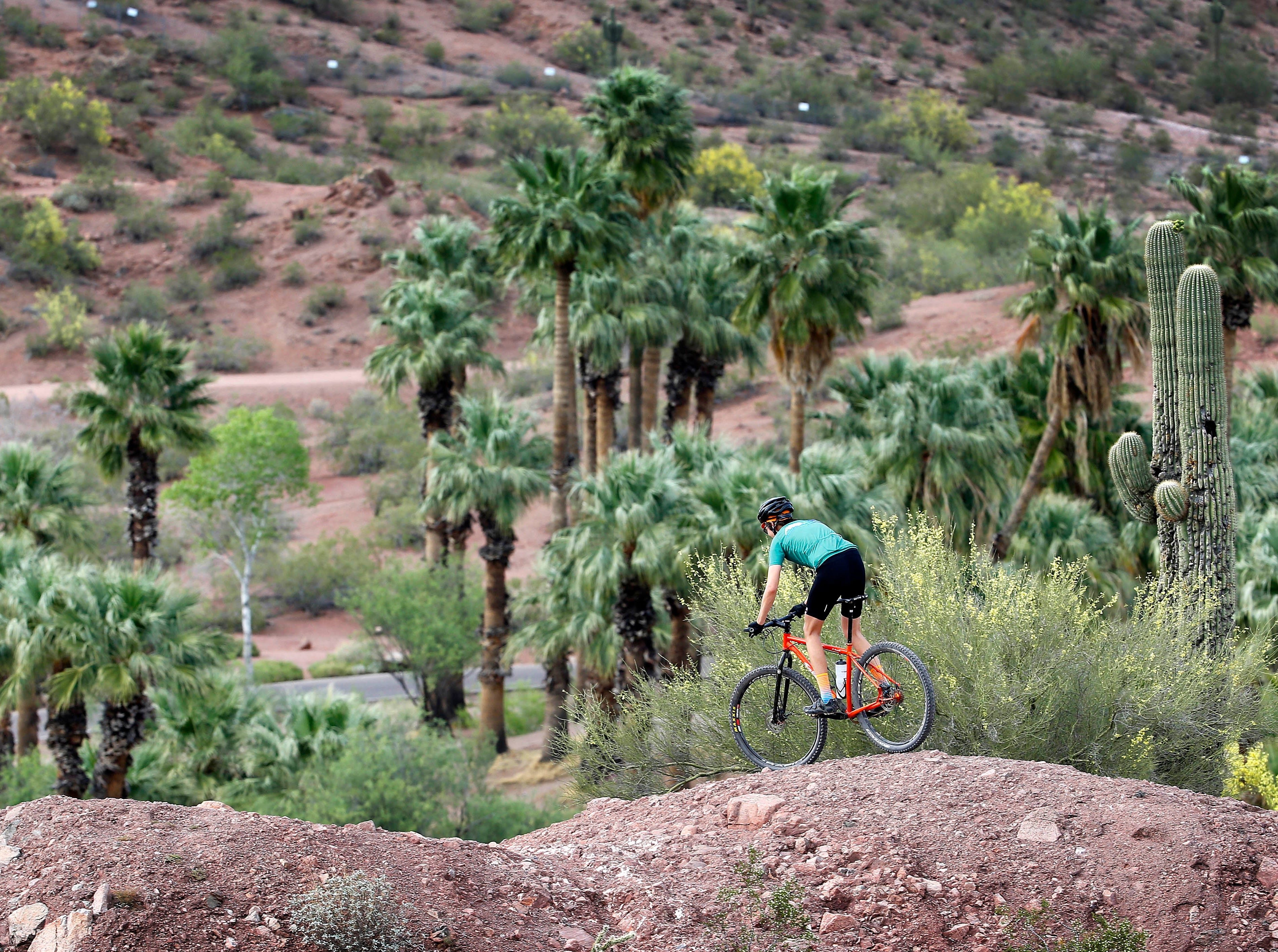 Geoff Carr enjoys the perfect weather as he rides his bike through Papago Park April 19, 2016, in Phoenix.