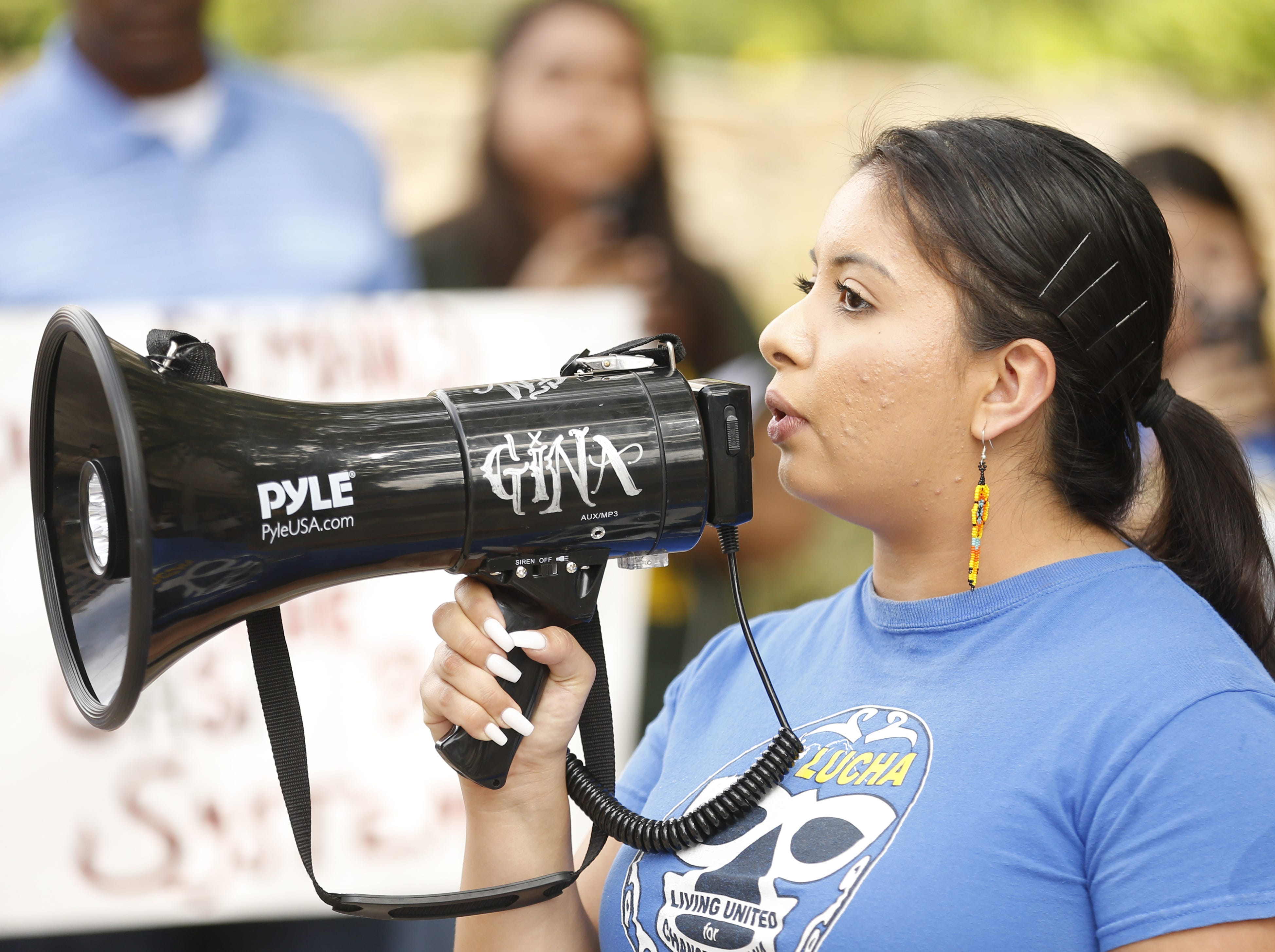 Astrid Pizarro, mass liberation organizer for LUCHA, speaks during a protest against cash bail at the Maricopa County Attorney's office in Phoenix on May 9, 2019.