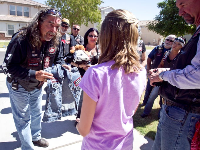 Pipes of Bikers Against Child Abuse gives a jean vest with the group's patch on the back to a child who has been the victim of abuse. The group aims to empower children who have been abused by offering to protect them, day or night.