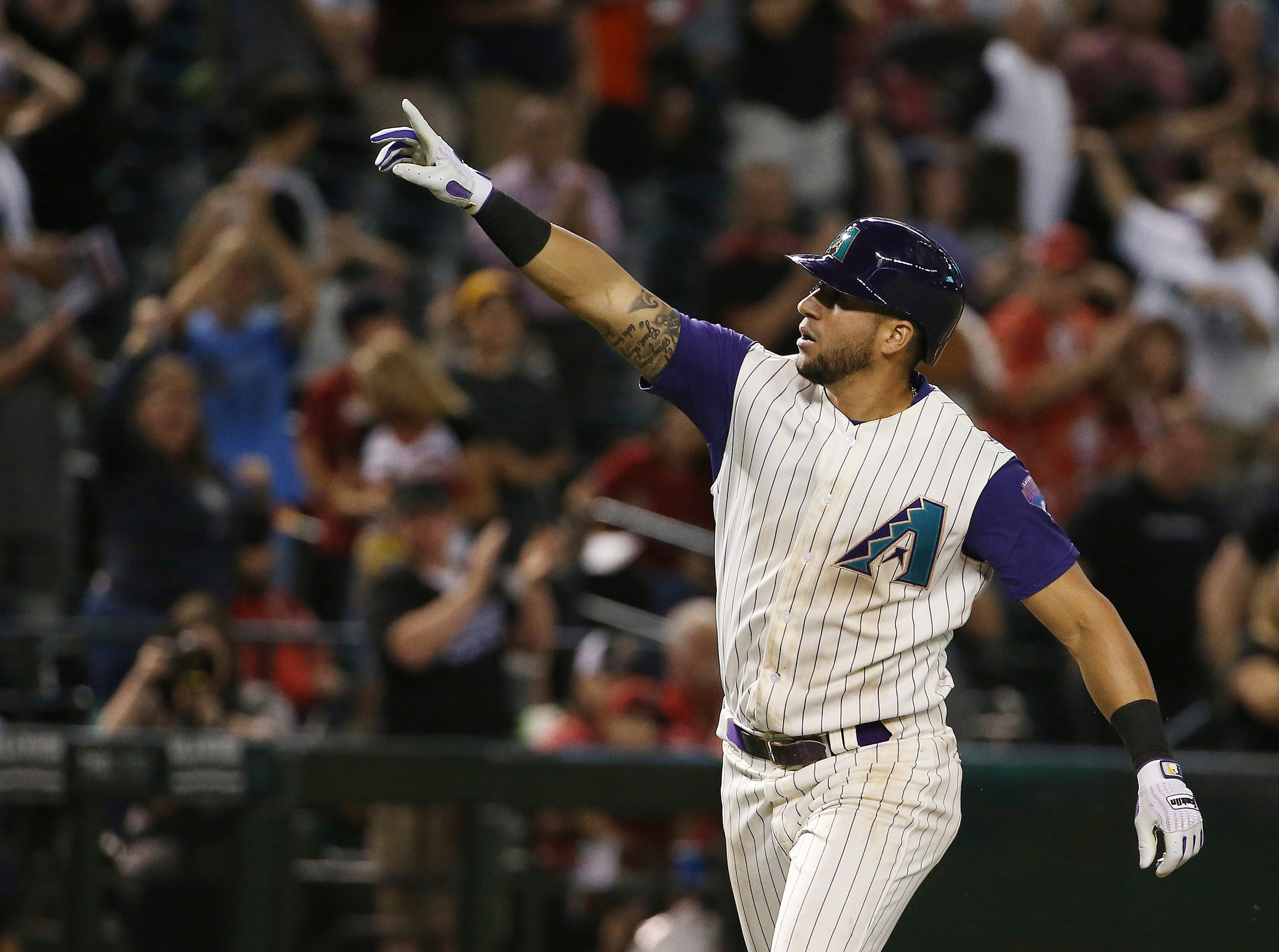 Arizona Diamondbacks' David Peralta celebrates his home run against the Atlanta Braves during the ninth inning of a baseball game Thursday, May 9, 2019, in Phoenix. (AP Photo/Ross D. Franklin)