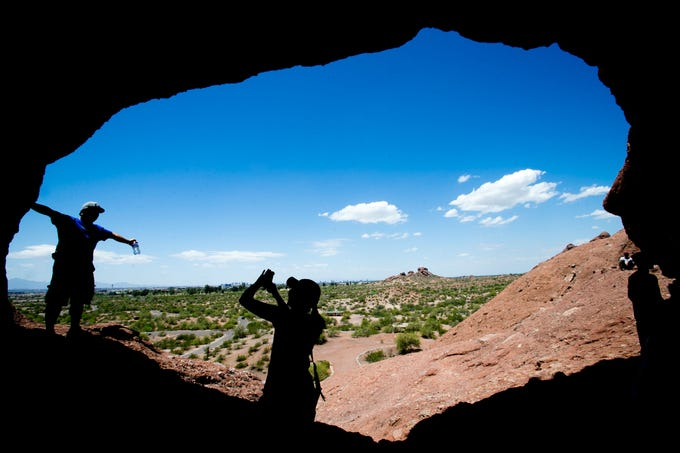 Matt Mrachek has his photo taken by Maria Vu at Hole in the Rock in Papago Park in Phoenix on May 22, 2015.