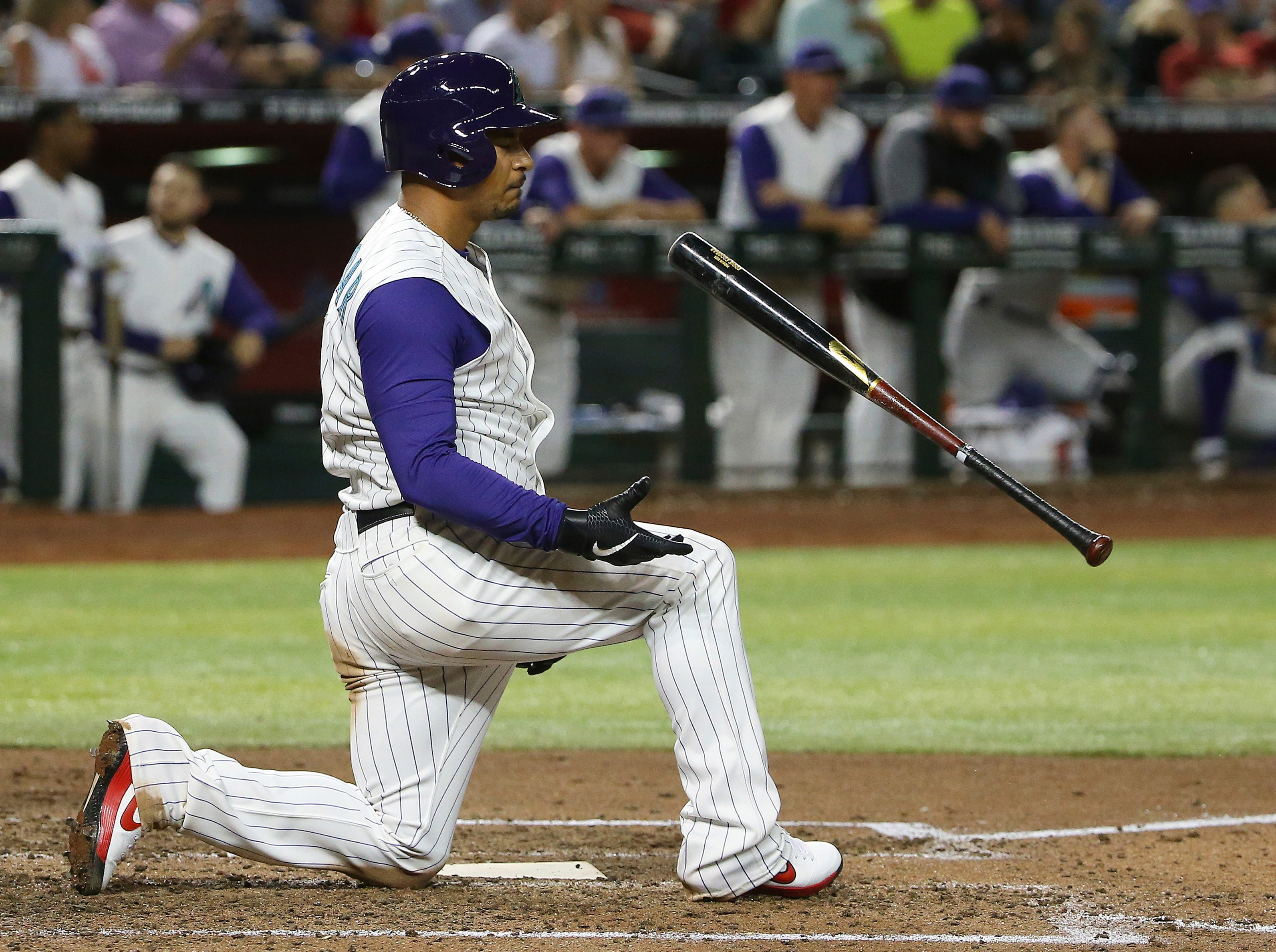 Arizona Diamondbacks' Eduardo Escobar flips his bat in the air after swinging and missing on a second strike against the Atlanta Braves during the fifth inning of a baseball game Thursday, May 9, 2019, in Phoenix. (AP Photo/Ross D. Franklin)