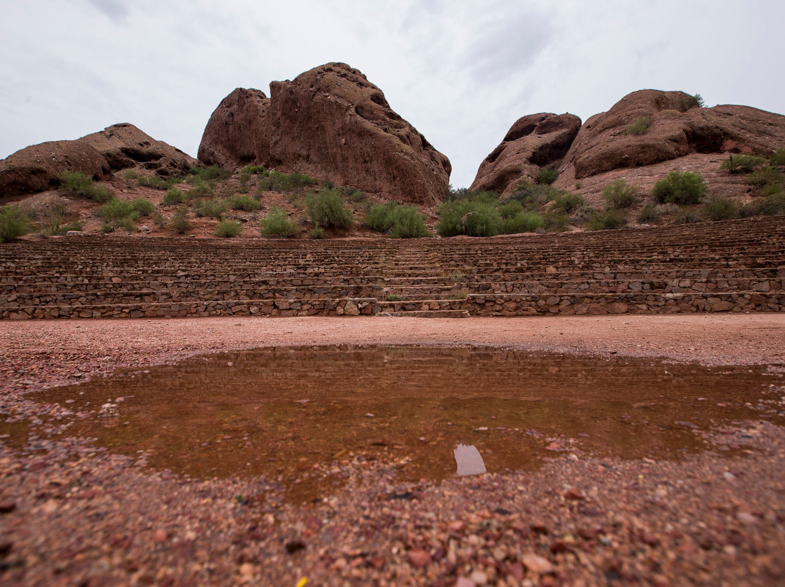 A puddle is pictured at the Papago Park amphitheater on  Oct. 1, 2018, in Phoenix.