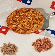 A bacon cheddar cheeseburger pizza from Domino's, specially created for Downtown Lebanon Burger Week.