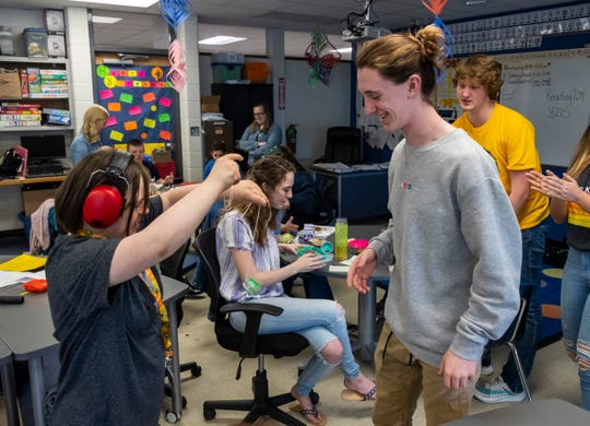Port huron Northern 12th-grader Cole Briggs, right, teaches 9th-grader Chloe David a yo-yo trick Friday, May 10, 2019, during a Lunch Buddies meeting at the school. Lunch Buddies is a program that lets some of the school's special education students have lunch with members of the Renaissance Club.