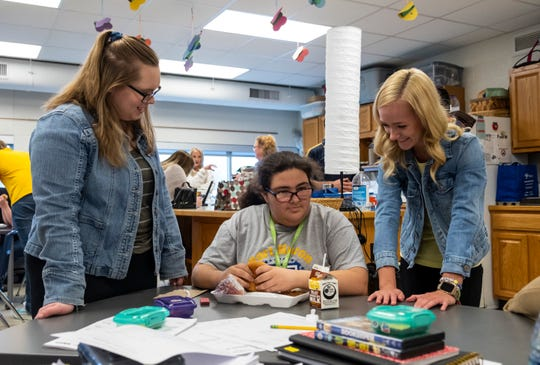 Port Huron Northern 11th-graders Abby Guilloz, left, and Madeline Sanderson, right, have lunch with 9th-grader Angel McClintock Friday, May 10, 2019 at a Lunch Buddies meeting at the school. Lunch Buddies is a program that lets some of the school's special education students have lunch with members of the Renaissance Club.