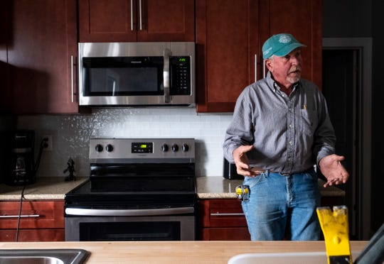 Developer Larry Jones speaks in the kitchen of a unit inside the Ballentine building Friday, May 10, 2019.