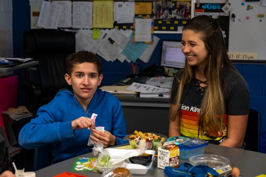 Port Huron Northern 11th-grader Ava Stoneberg, right, has lunch with 10th-grader Keyandre Johnson Friday, May 10, 2019 during a Lunch Buddies meeting at the school. Lunch Buddies is a program that lets some of the school's special education students have lunch with members of the Renaissance Club.