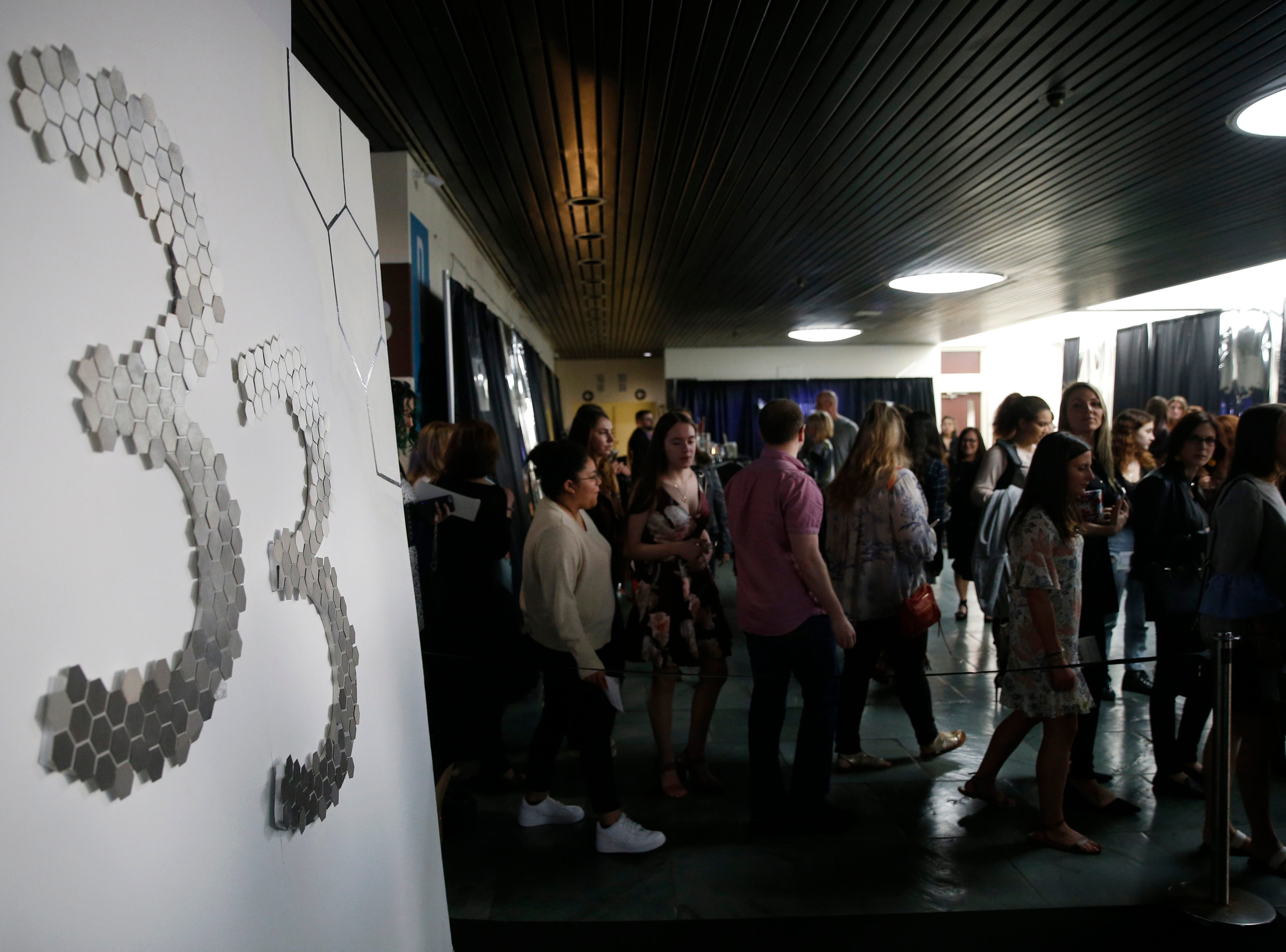 Guests exit the 33rd Marist College Silver Needle Runway Show on May 10, 2019.