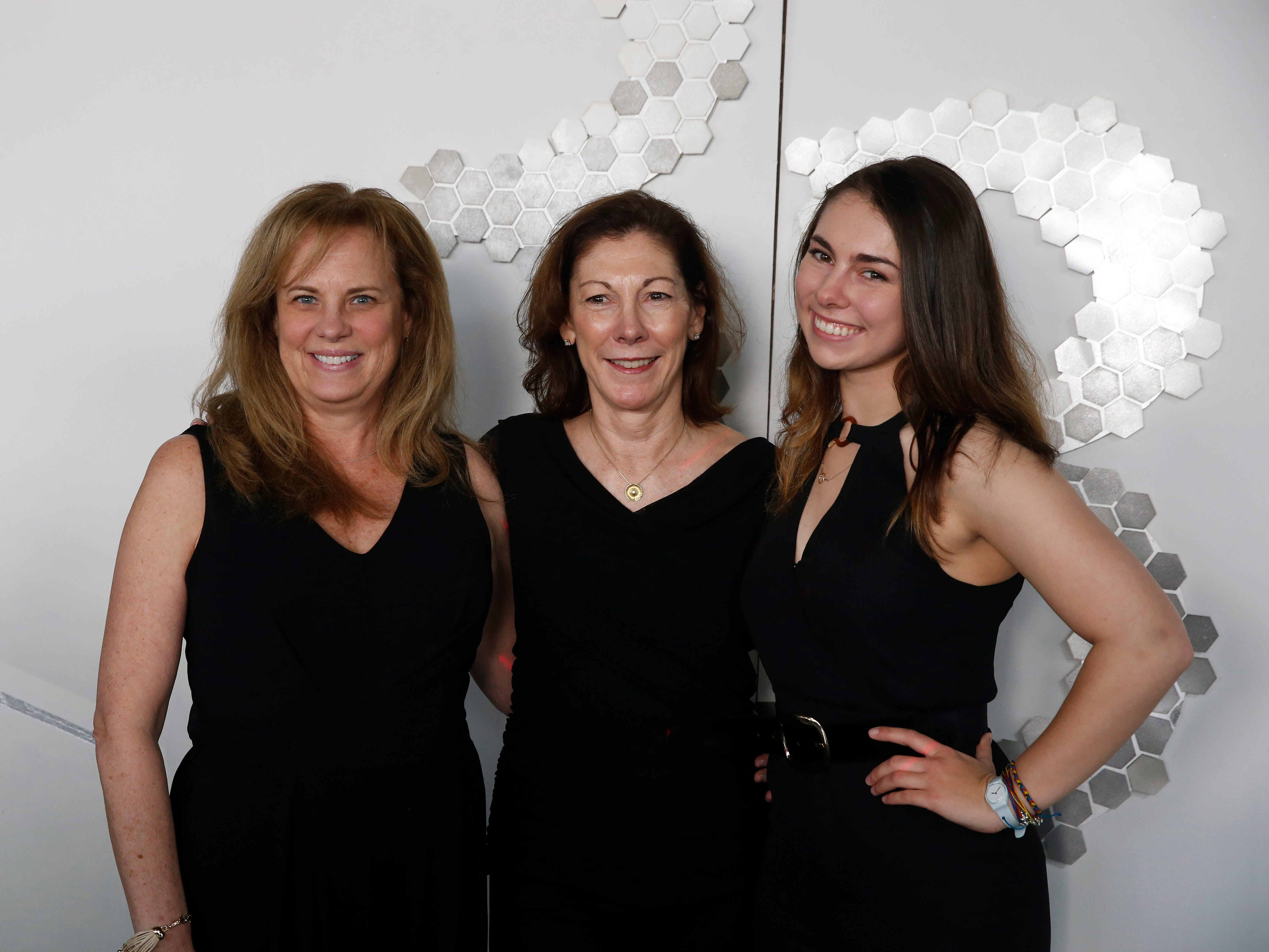 From left, Susan Kretz of Newtown, Connecticut, Susan Moody of Hoboken, New Jersey and her daughter Katie Moody a Marist College Fashion Department freshman pose for a photo at the step and repeat before the 33rd Marist College Silver Needle Runway Show on May 10, 2019.