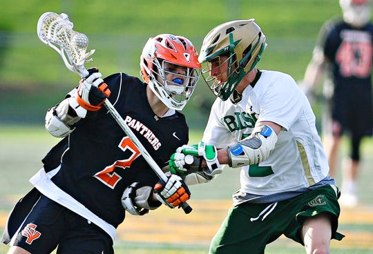 Central York's Drake Little, left, works to get past York Catholic's Massimo Antolick during lacrosse championship action at Eastern York Senior High School in Wrightsville, Friday, May 10, 2019. Central York would win the title game 13-5. Dawn J. Sagert photo