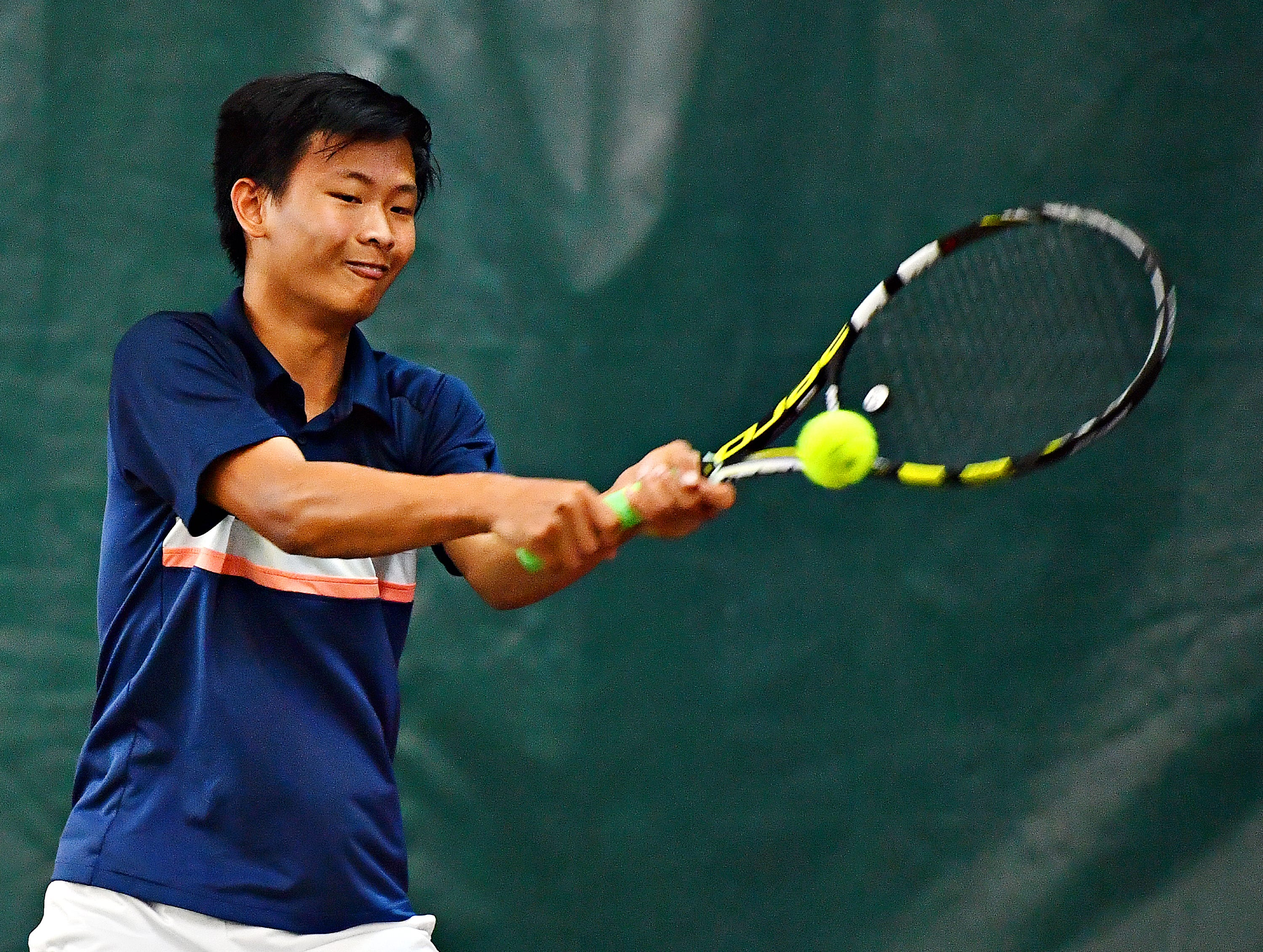 Hershey's Andy Chen returns the ball to Dallastown's Jonathan Burns during District III, Class 3-A boys' tennis team championship action at Hershey Raquet Club in Hershey, Thursday, May 9, 2019. Chen would win the match and Hershey would win the title. Dawn J. Sagert photo