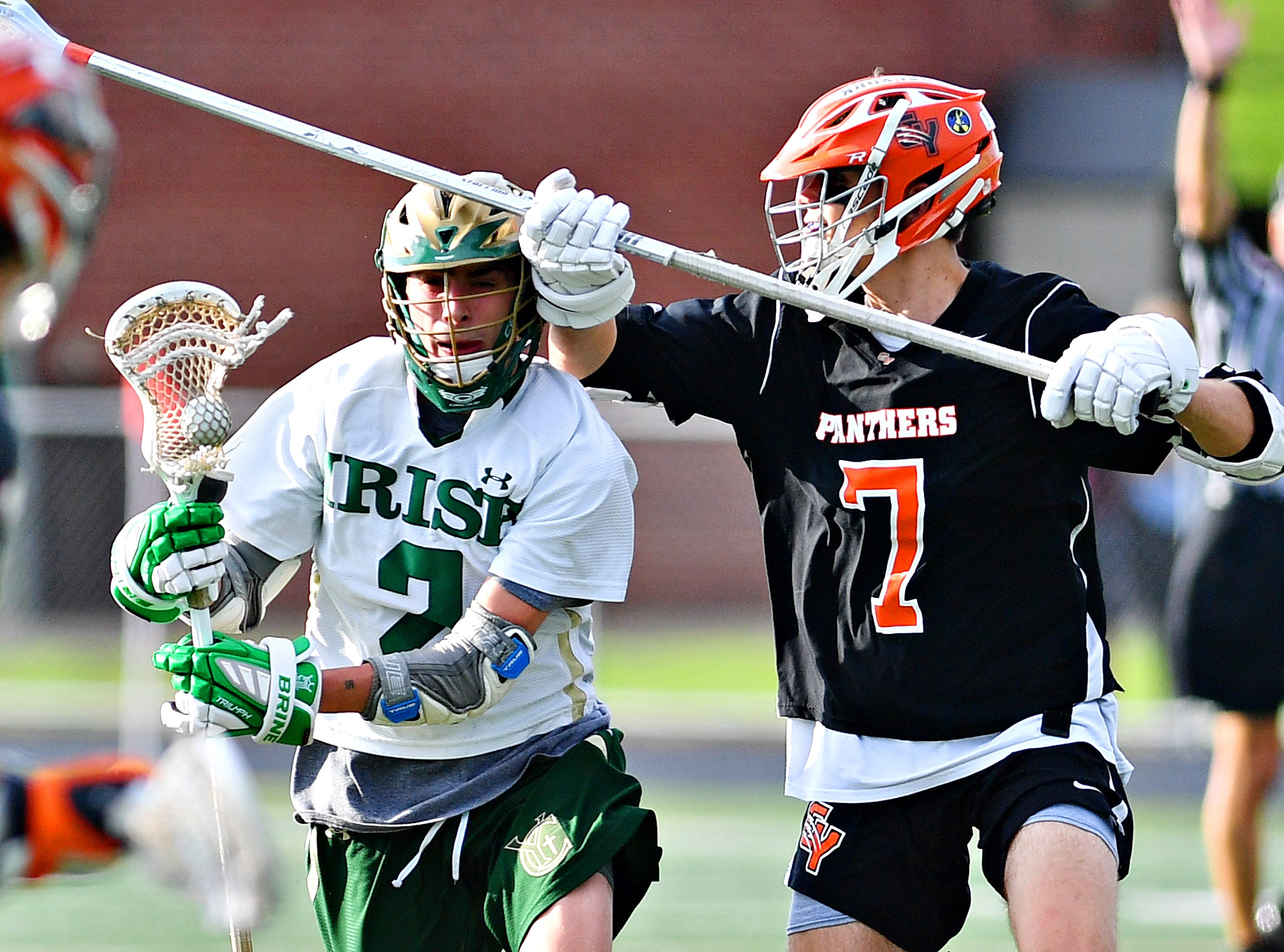 York Catholic's Massimo Antolick, left, controls the ball while Central York's Robert Stockbower defends during lacrosse championship action at Eastern York Senior High School in Wrightsville, Friday, May 10, 2019. Central York would win the title game 13-5. Dawn J. Sagert photo