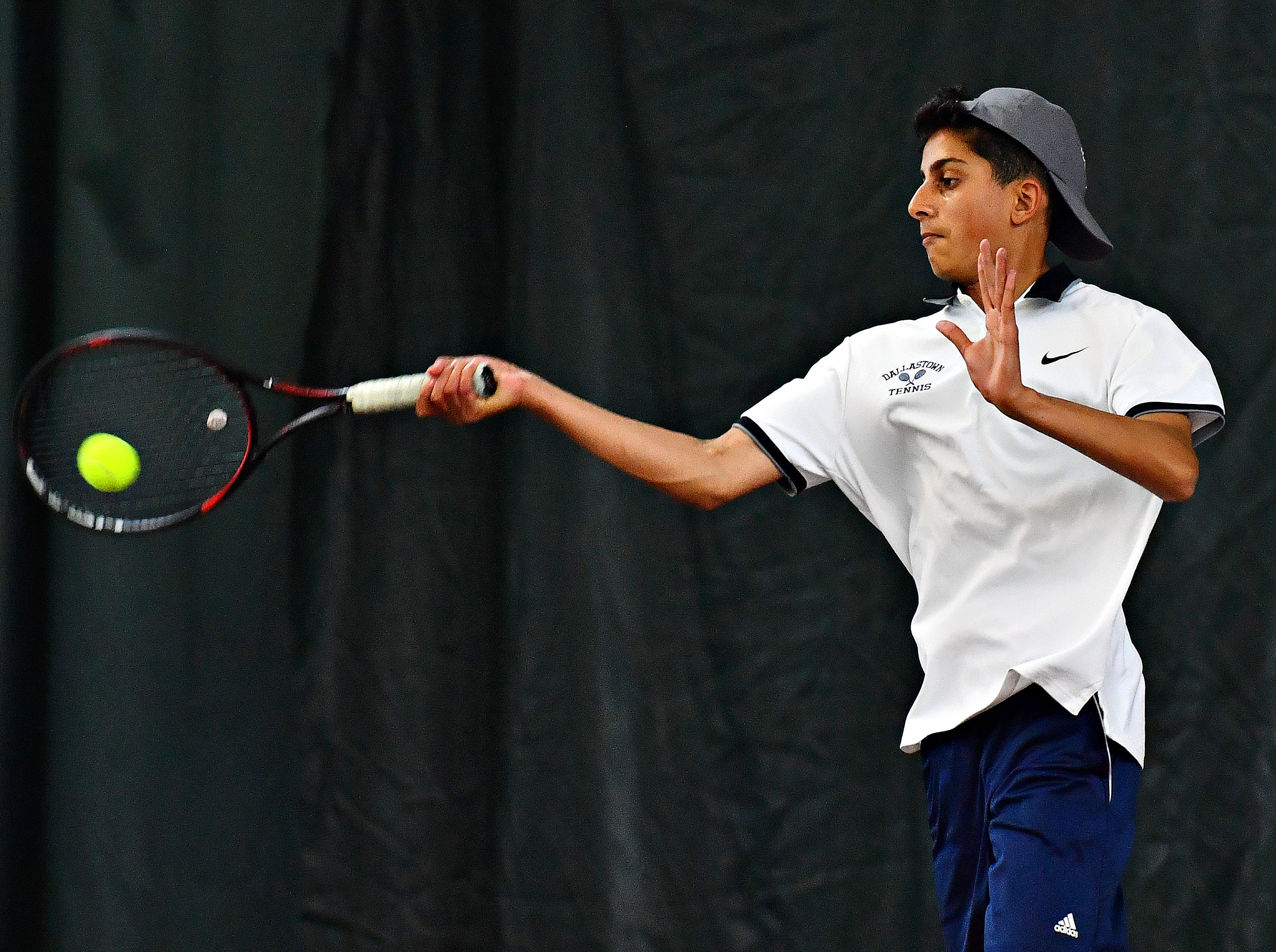 Dallastown's Aryan Saharan returns the ball to Hershey during District III, Class 3-A boys' tennis team championship doubles action at Hershey Raquet Club in Hershey, Thursday, May 9, 2019. Hershey would win the match as well as the title. Dawn J. Sagert photo