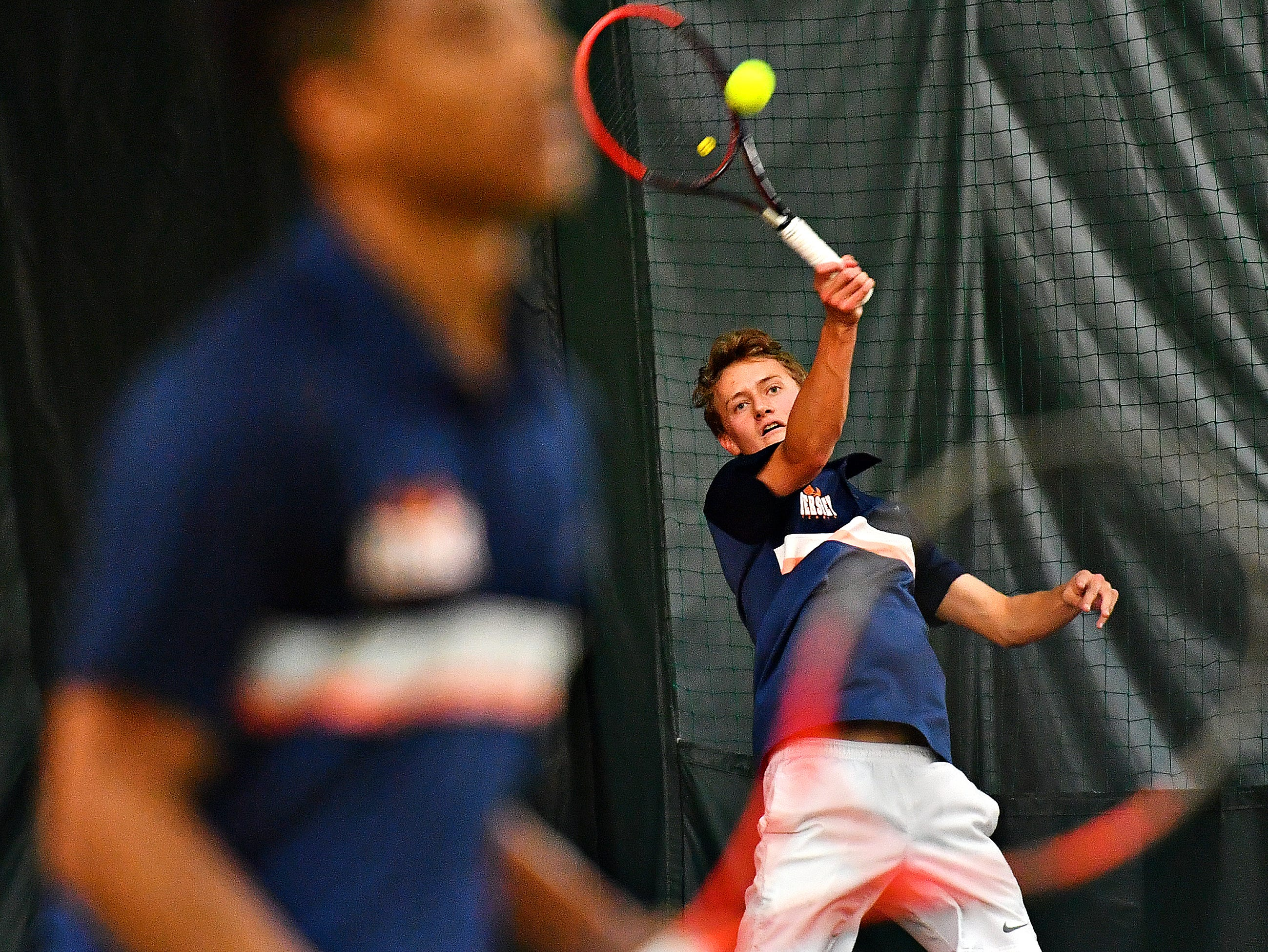 Hershey's Nate Shaw, back, returns the ball to Dallastown while teammate JT Mullins looks on during District III, Class 3-A boys' tennis team championship doubles action at Hershey Raquet Club in Hershey, Thursday, May 9, 2019. Hershey would win the match as well as the title. Dawn J. Sagert photo