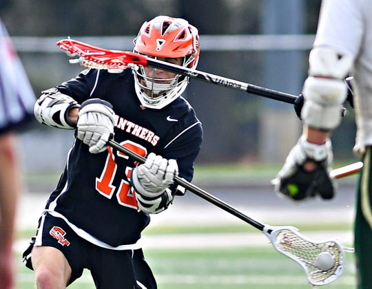 Central York's Logan Paluch shoots on goal during lacrosse championship action against York Catholic at Eastern York Senior High School in Wrightsville, Friday, May 10, 2019. Central York would win the title game 13-5. Dawn J. Sagert photo