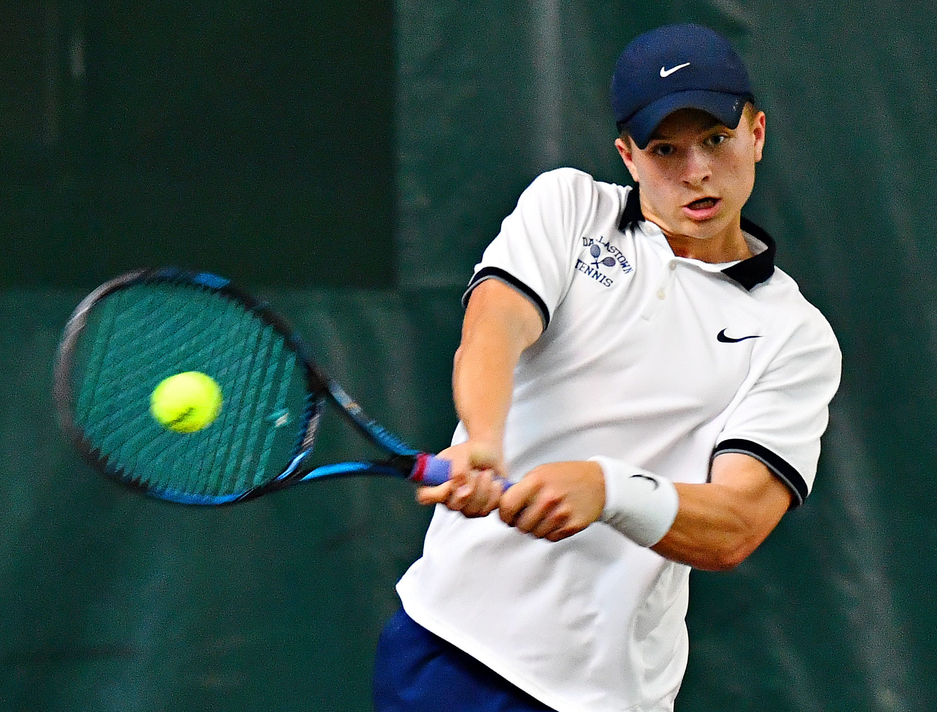 Dallastown's Holden Koons returns the ball to Hershey's Andreas Wingert during District III, Class 3-A boys' tennis team championship action at Hershey Raquet Club in Hershey, Thursday, May 9, 2019. Koons would win the match and Hershey would win the title. Dawn J. Sagert photo