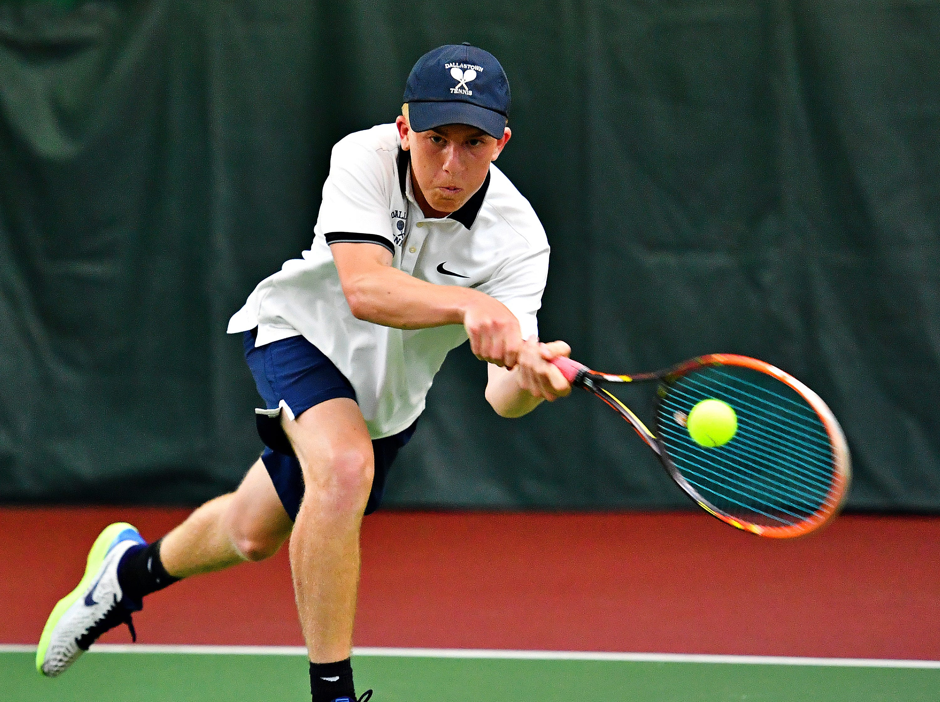 Dallastown's Cameron Koons returns the ball to Hershey during District III, Class 3-A boys' tennis team championship doubles action at Hershey Raquet Club in Hershey, Thursday, May 9, 2019. Dallastown would win the match, but Hershey would secure the title. Dawn J. Sagert photo