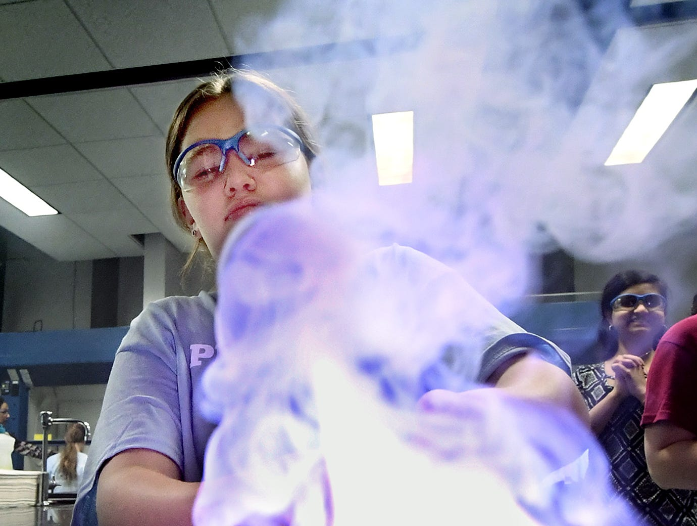 Harrisburg Academy student Annabel Hathaway lights a mixture during the Sparkling with Chemistry workshop at the Pathways to Your Future: Exploring STEAM Careers event at Penn State York Friday, May 10, 2019. Over 200 seventh-grade girls from 28 area schools participated in the program which highlighted science, technology, engineering, art, and mathematics (STEAM) careers. Industry leaders administered the workshops during the program, which is in its 23rd year. Bill Kalina photo