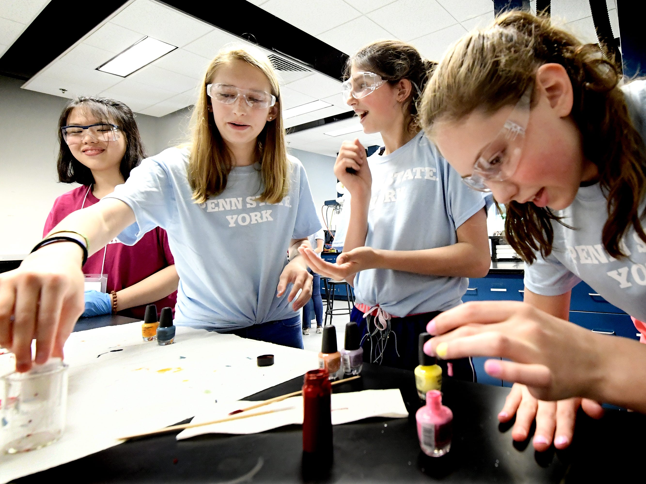 Penn State student aide Jenny Du, left, watches as Dallastown Middle School students, from left, Kaitlyn Bailey, Emerson Dunker and Elliot Post-Kulisiewicz make and sample nail polish during The Science of Color in Cosmetics workshop at the Pathways to Your Future: Exploring STEAM Careers event at Penn State York Friday, May 10, 2019. Over 200 seventh-grade girls from 28 area schools participated in the program which highlighted science, technology, engineering, art, and mathematics (STEAM) careers. Industry leaders administered the workshops during the program, which is in its 23rd year. Bill Kalina photo
