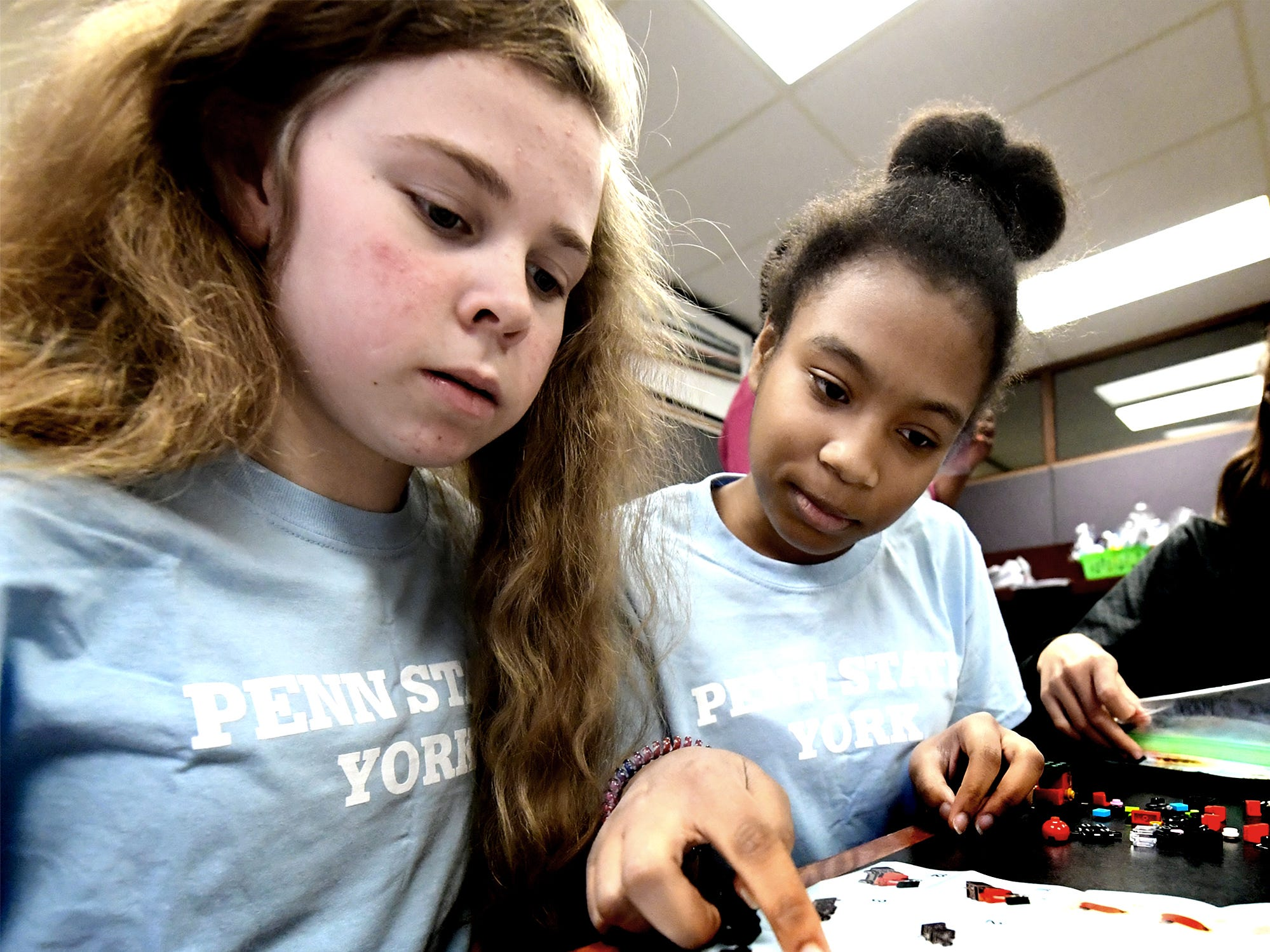 South Eastern Middle School students Chloe Jones, left, and Gabby Williams work on a puzzle during Marshmallow Minds, a social science workshop at the Pathways to Your Future: Exploring STEAM Careers event at Penn State York Friday, May 10, 2019. Over 200 seventh-grade girls from 28 area schools participated in the program which highlighted science, technology, engineering, art, and mathematics (STEAM) careers. Industry leaders administered the workshops during the program, which is in its 23rd year. Bill Kalina photo