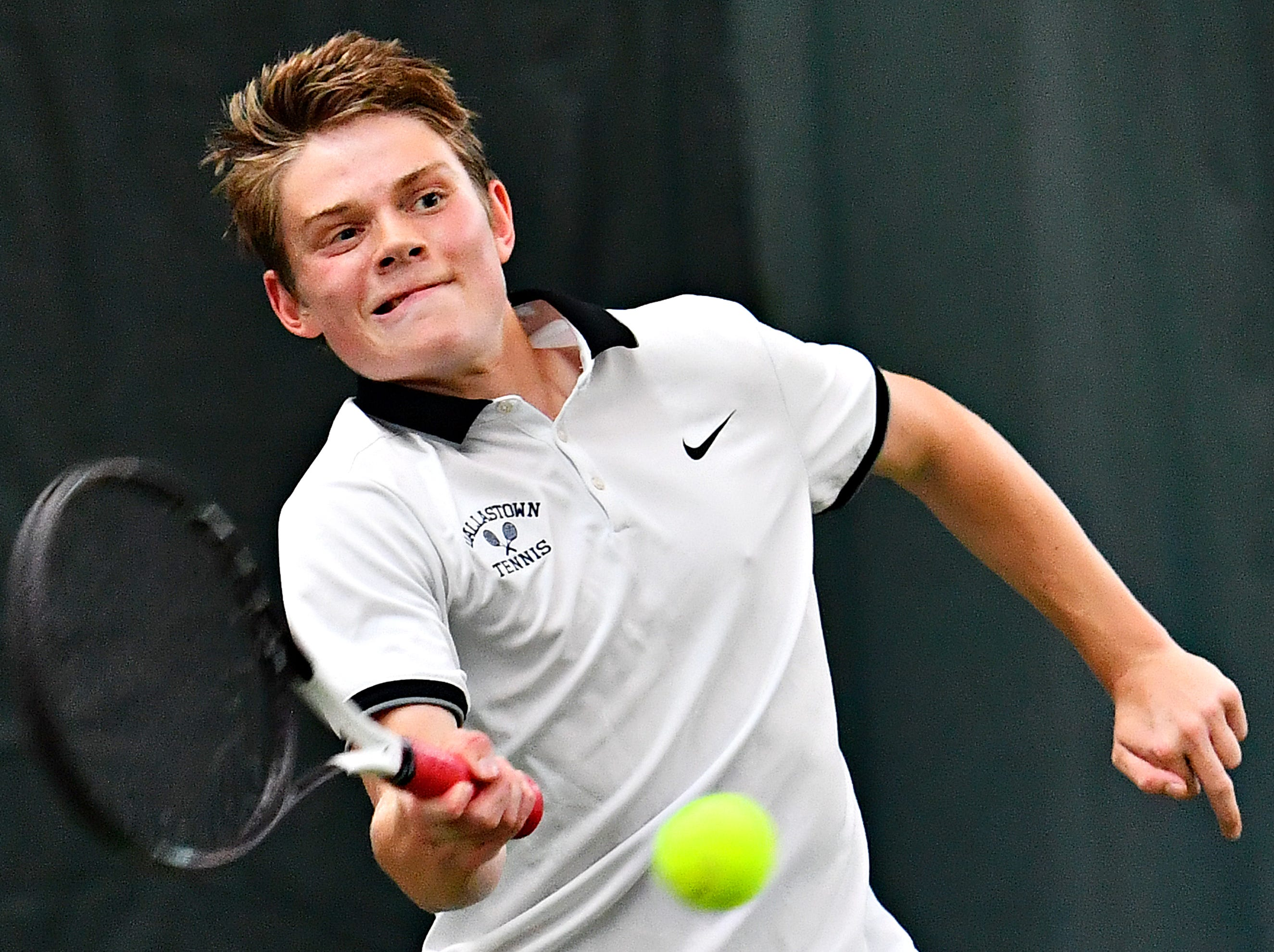 Dallastown's Jack Lynam returns the ball to Hershey during District III, Class 3-A boys' tennis team championship doubles action at Hershey Raquet Club in Hershey, Thursday, May 9, 2019. Dallastown would win the match, but Hershey would secure the title. Dawn J. Sagert photo